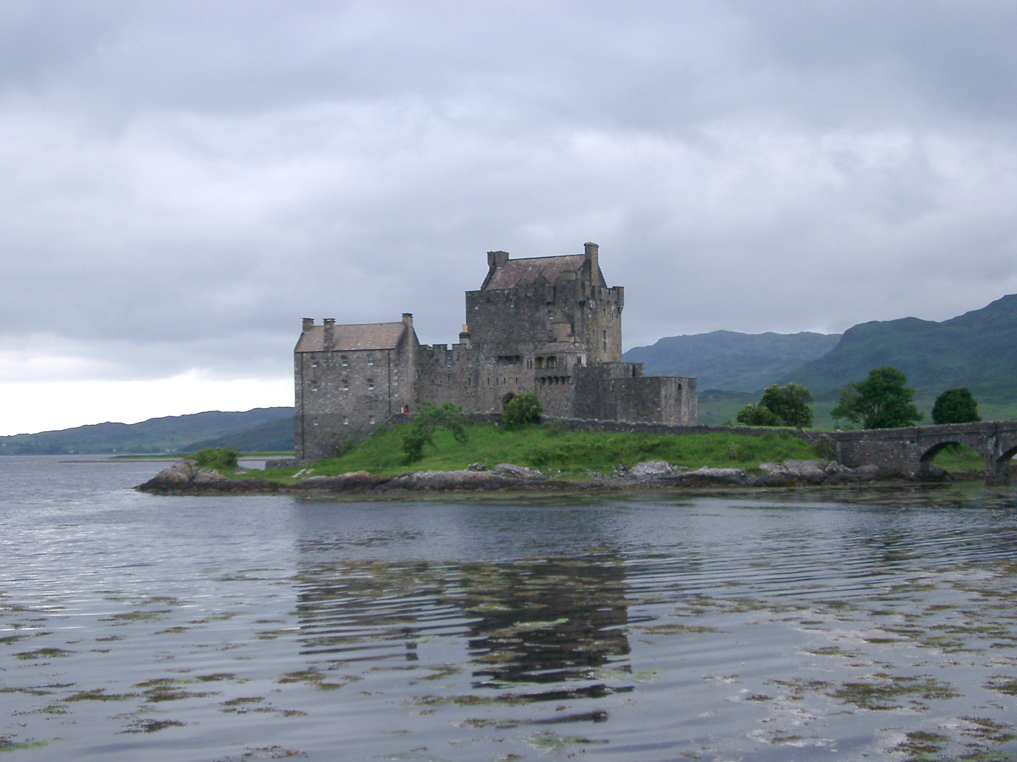 Eilean Donan Castle, Located in the Western Highlands of Scotland. Captured on the Afternoon with Gray Sky Background.