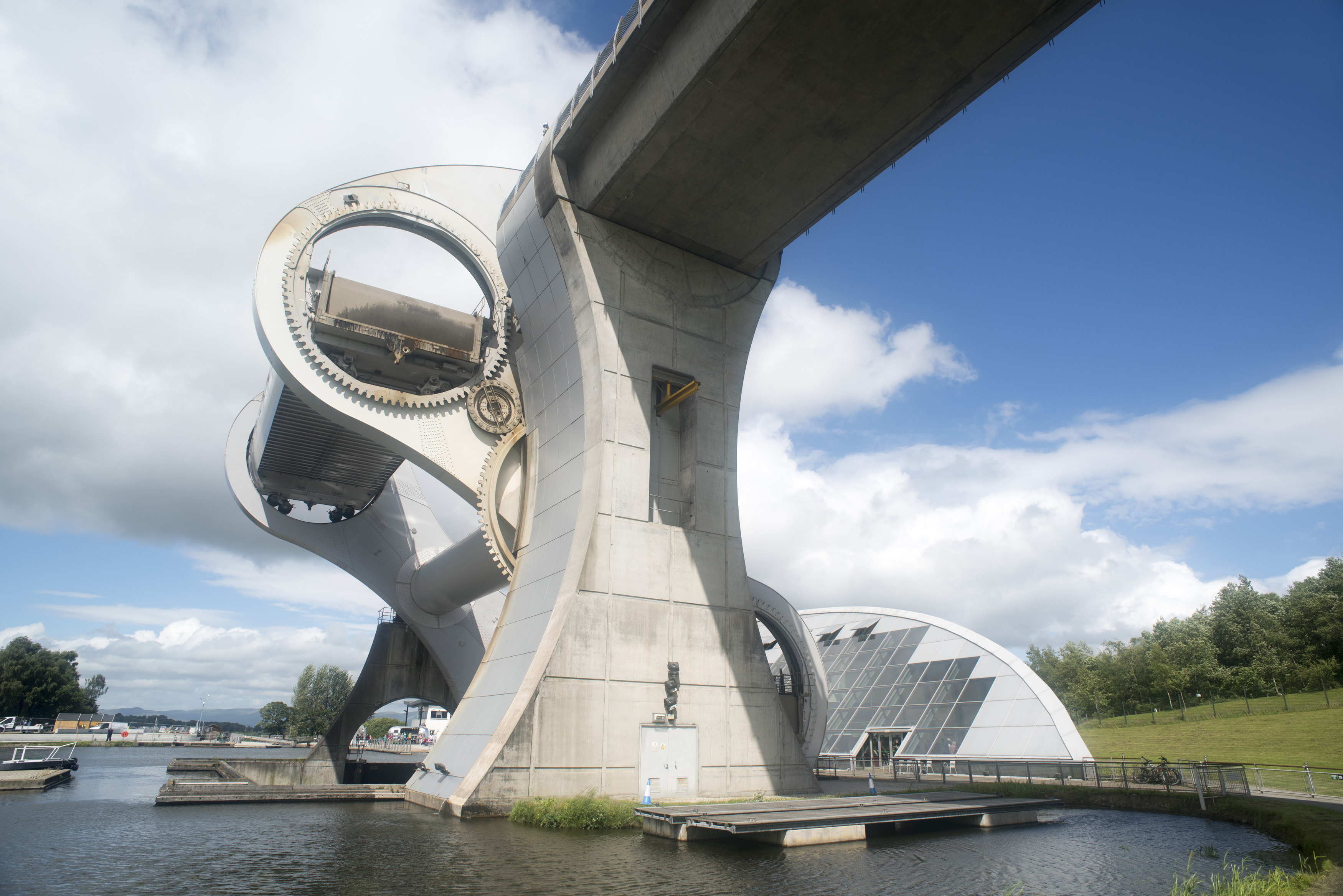 Low angle view of rotating boat lift in Scotland connecting two canals on a sunny day