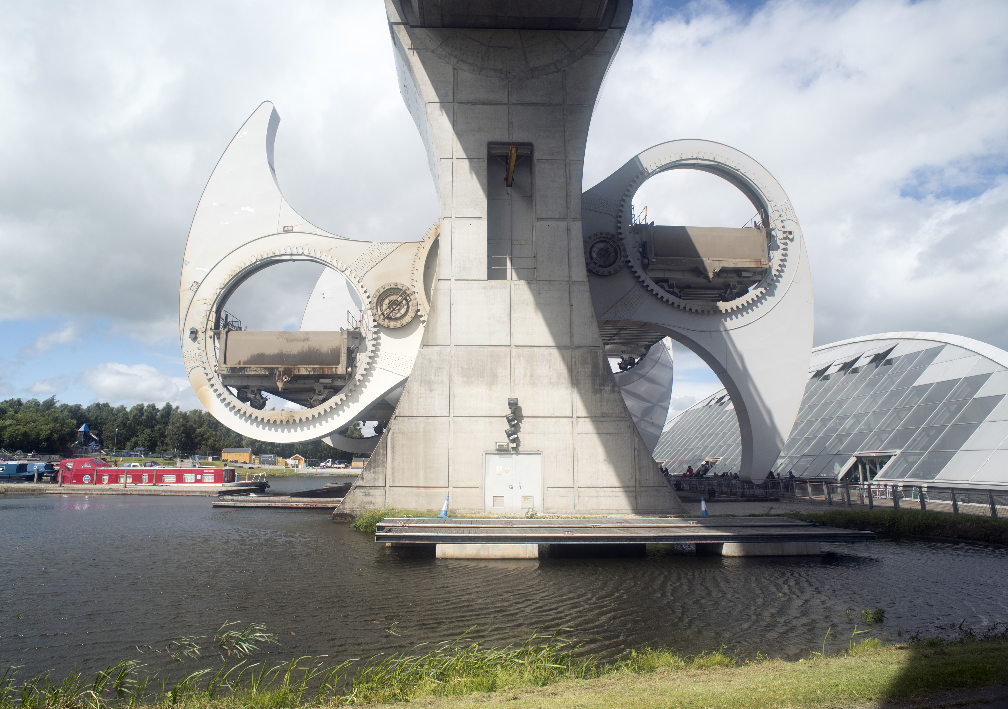 View from under viaduct at the giant Scottish Falkirk Wheel boat lift rotating showing off gears which hold boats