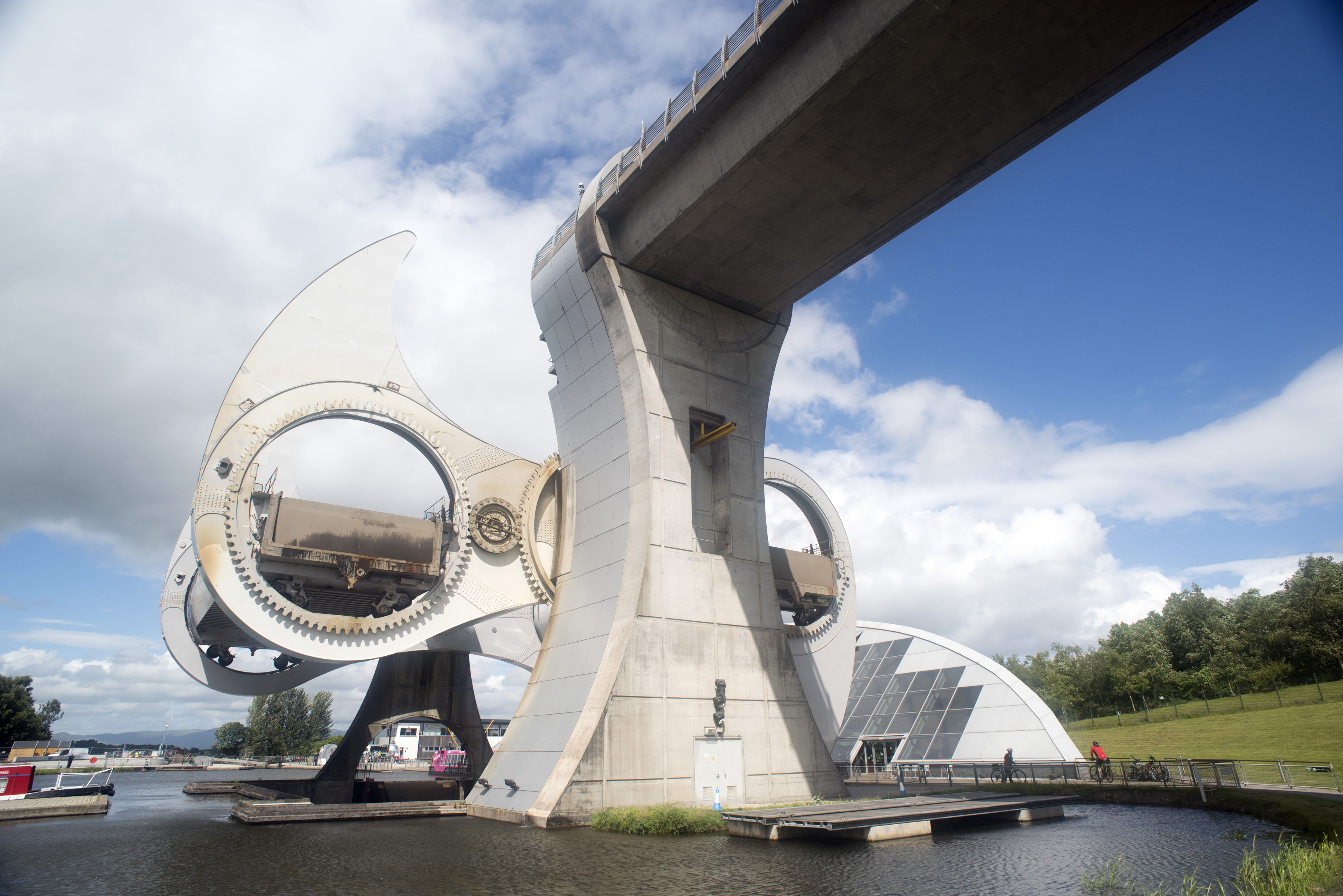 Uniquely shaped Falkirk wheel in Scotland as seen from a low angle view on a clear summer day