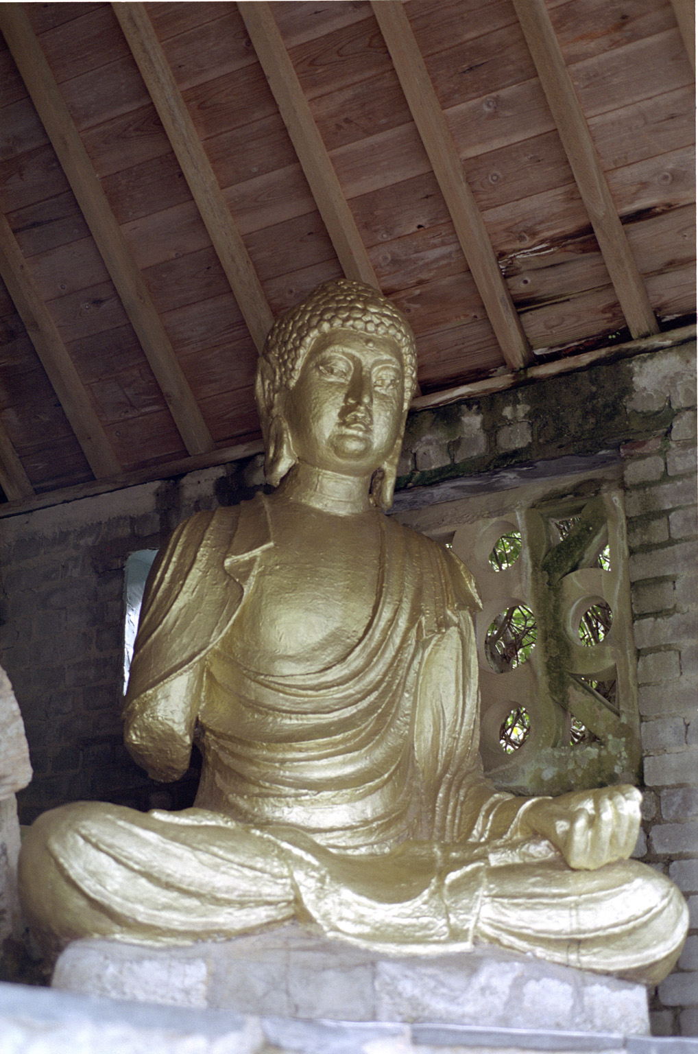 Seated Gold Buddha, a Gift to the Village of Portmeirion, a Popular Tourist Village in Gwynedd, North Wales