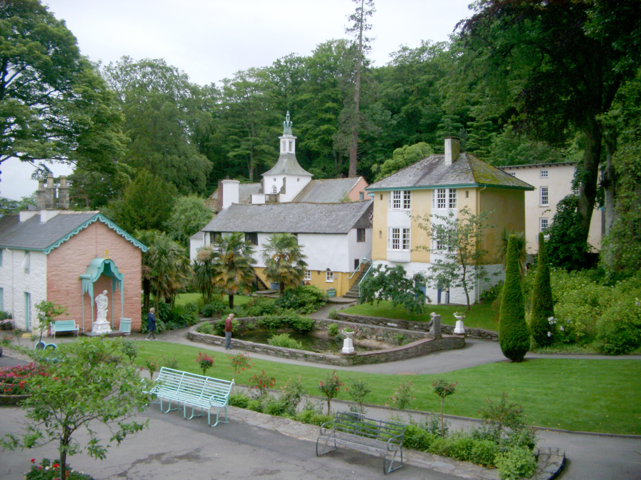 Quaint Buildings and Pond with Green Space in Portmeirion, a Popular Tourist Village in Gwynedd, North Wales