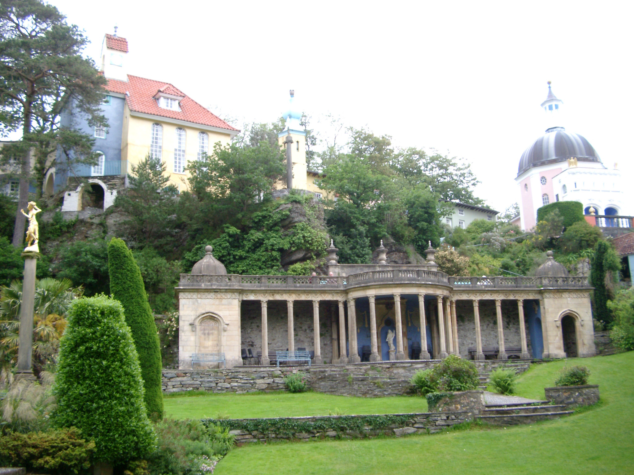 Portmeirion architecture, Wales, modeled on an Italian village , showing a building with a colonnade portico overlooking landscaped gardens in this popular tourist resort