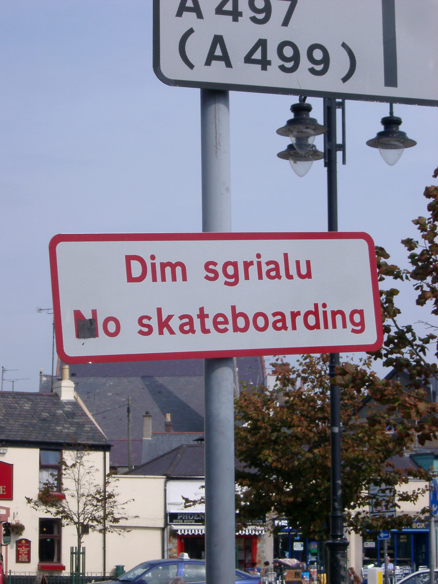 Close Up of Bi-lingual Welsh and English No Skateboarding Sign in Urban Setting