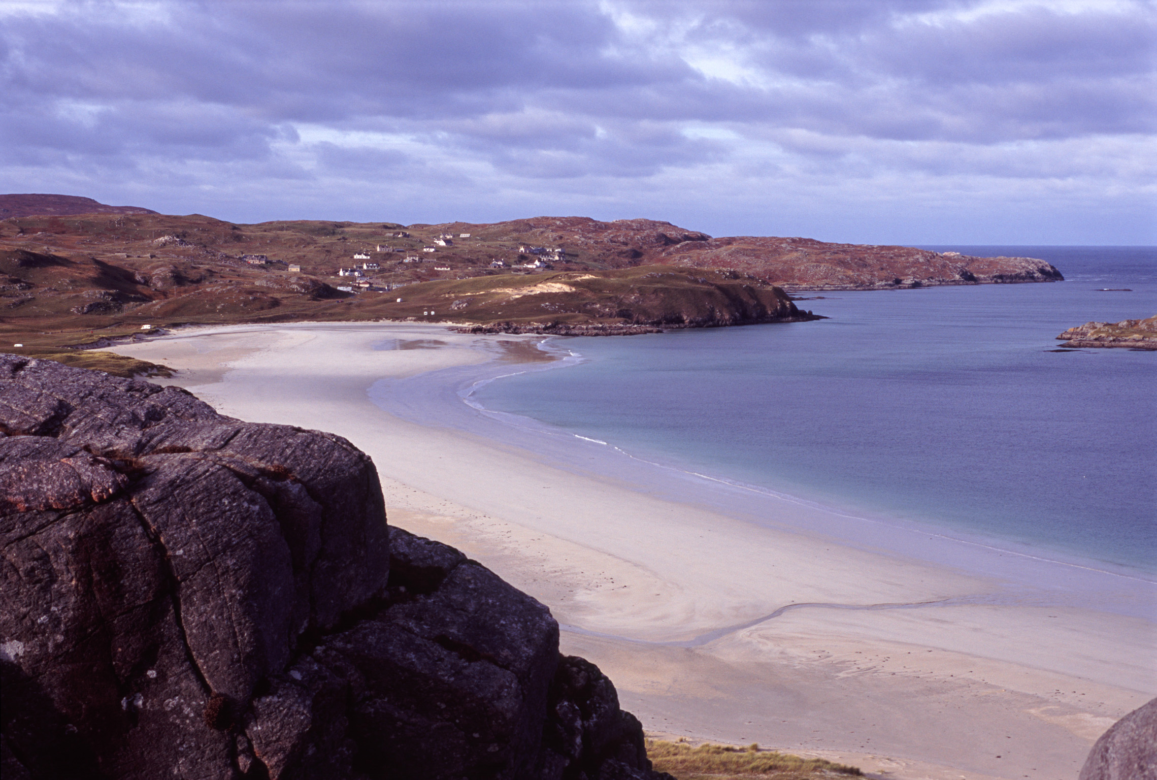 Landscape view of a quiet tranquil Hebridies beach with golden sand on the Isle of Lewis, Scotland