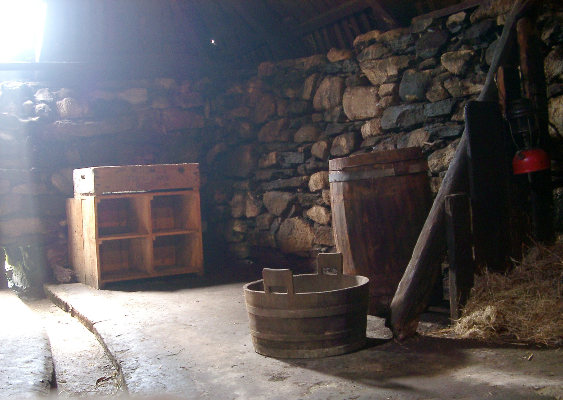 Interior of Traditional Scottish Stone Blackhouse with Historic Artifacts