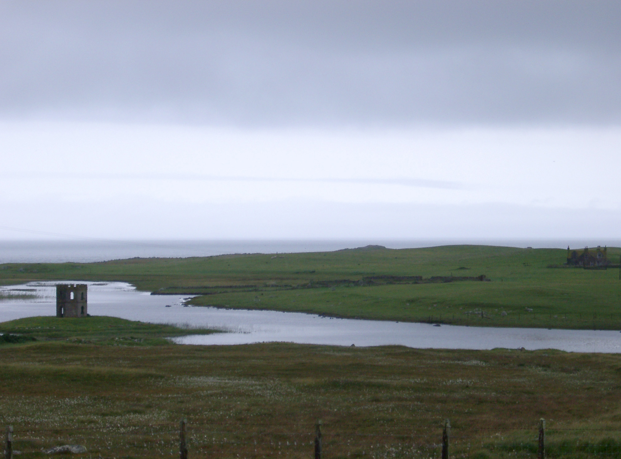 Landscape view of the historic Scolpaig Tower, a Georgian folly near the village of Scolpaig, Isle of North Uist, Outer Hebrides built around 1830 to provide employment during a time of famine