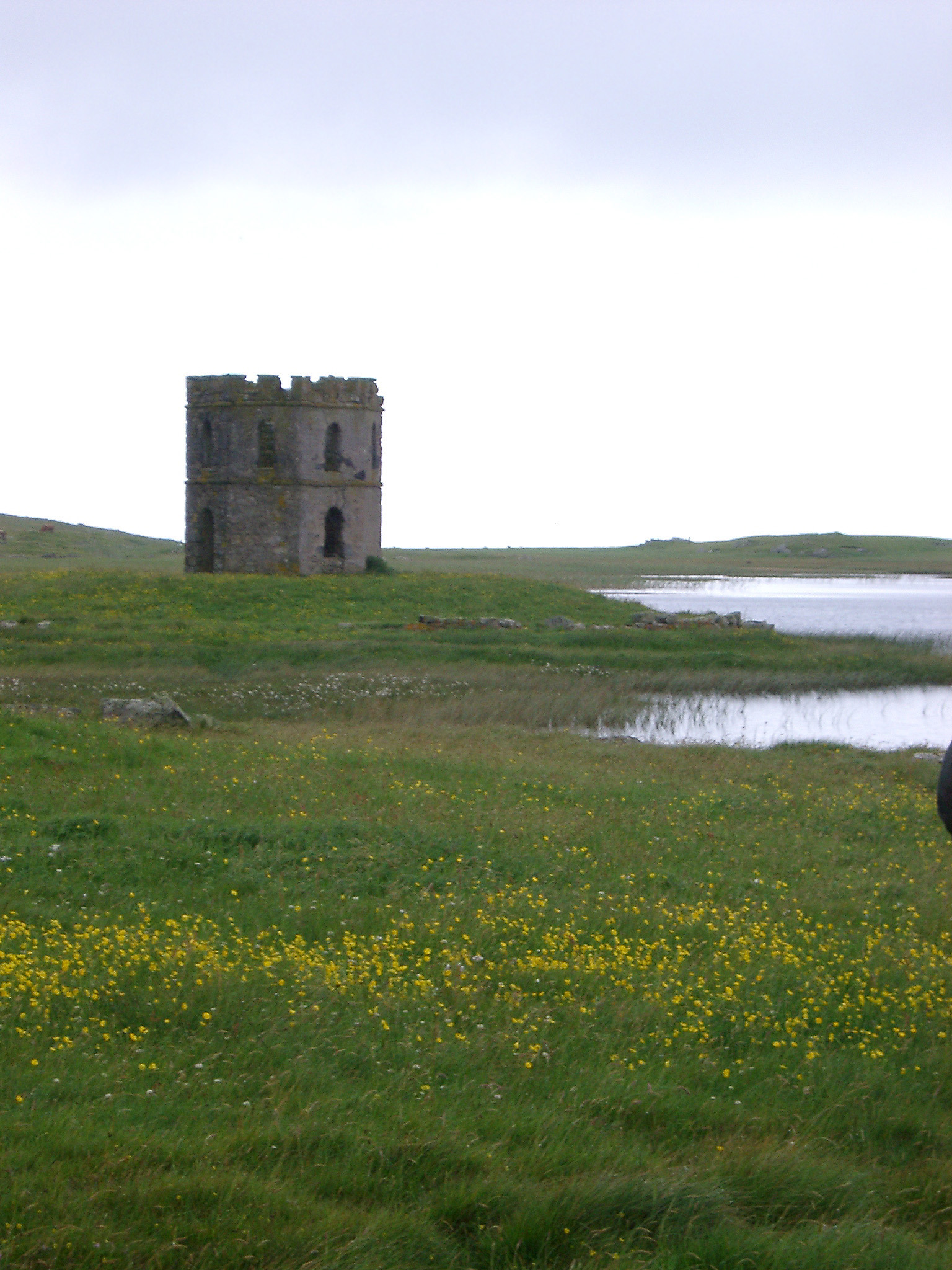View of Scolpaig Tower on Loch Shoreline on Overcast Day, Outer Hebrides, Scotland