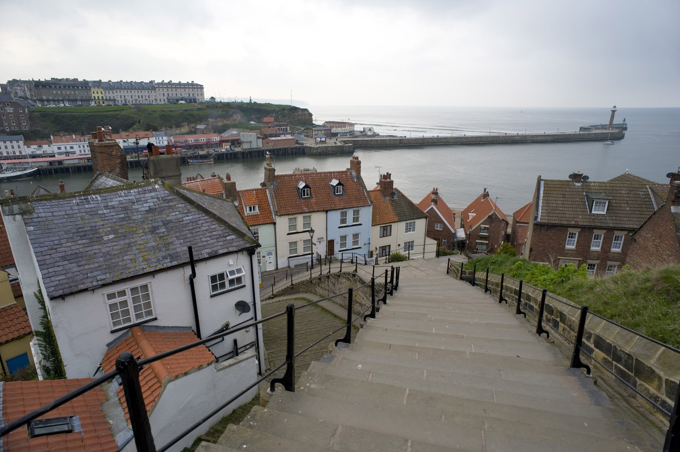 a view walking down the lower part of whitbys famous 199 steps into the town