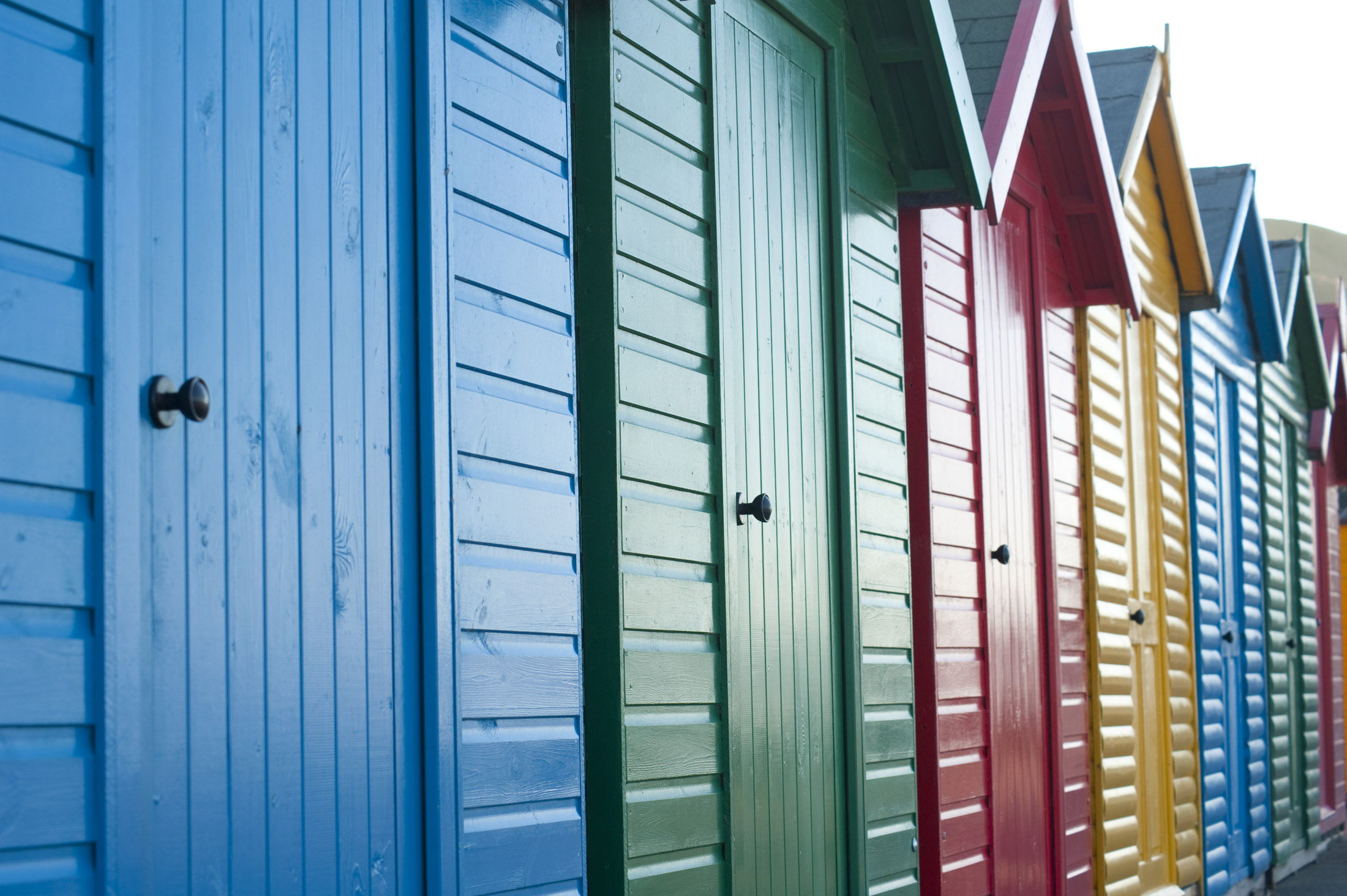 beach huts on the shore at whitbys west cliff