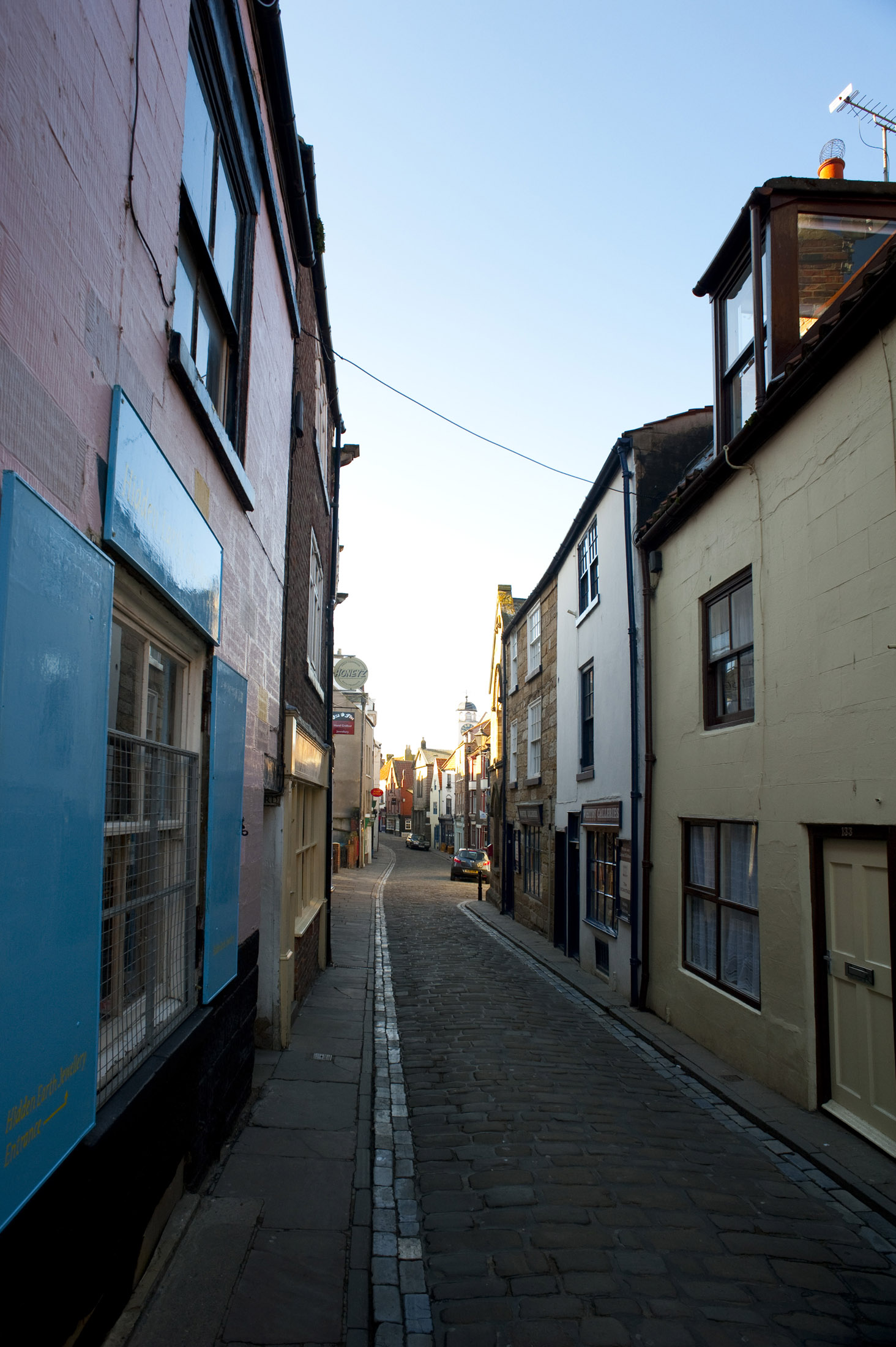 shops and houses along whitbys narrow church street