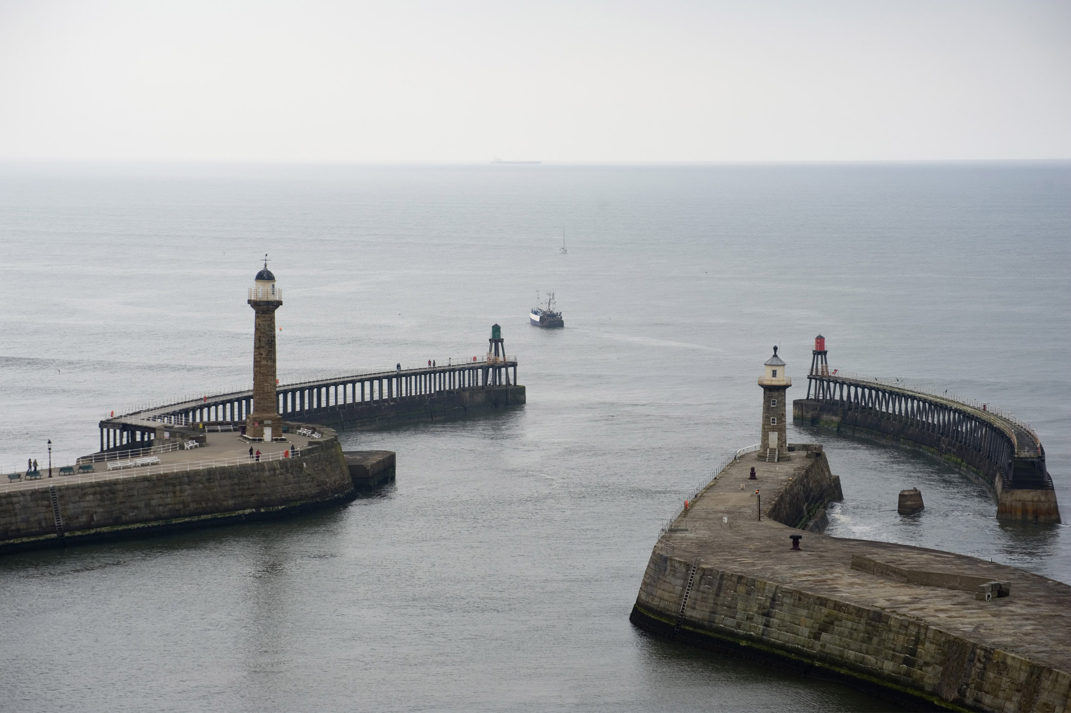 two large harbour piers protect the lower harbour from the sea, on the ends are two breakwaters which further reduce the swell entering the bay