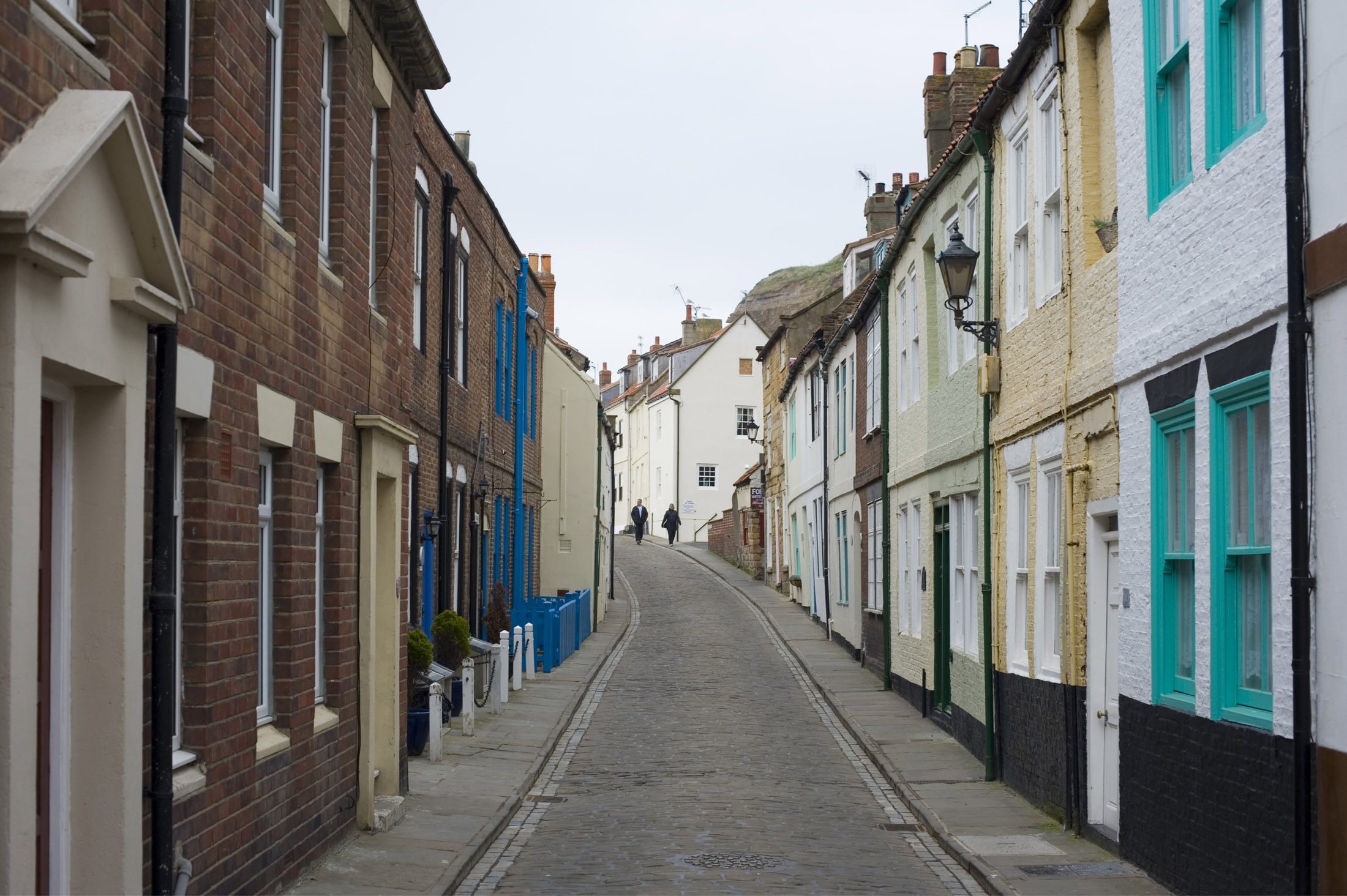 henrietta street lined with old fishing cottags on whitbys east cliff Street