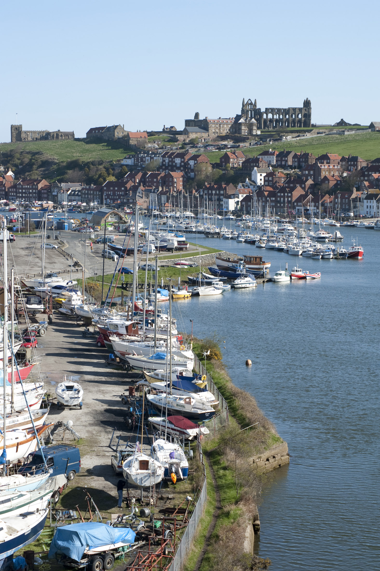 boats moored on the banks of the river esk flowing through whitby