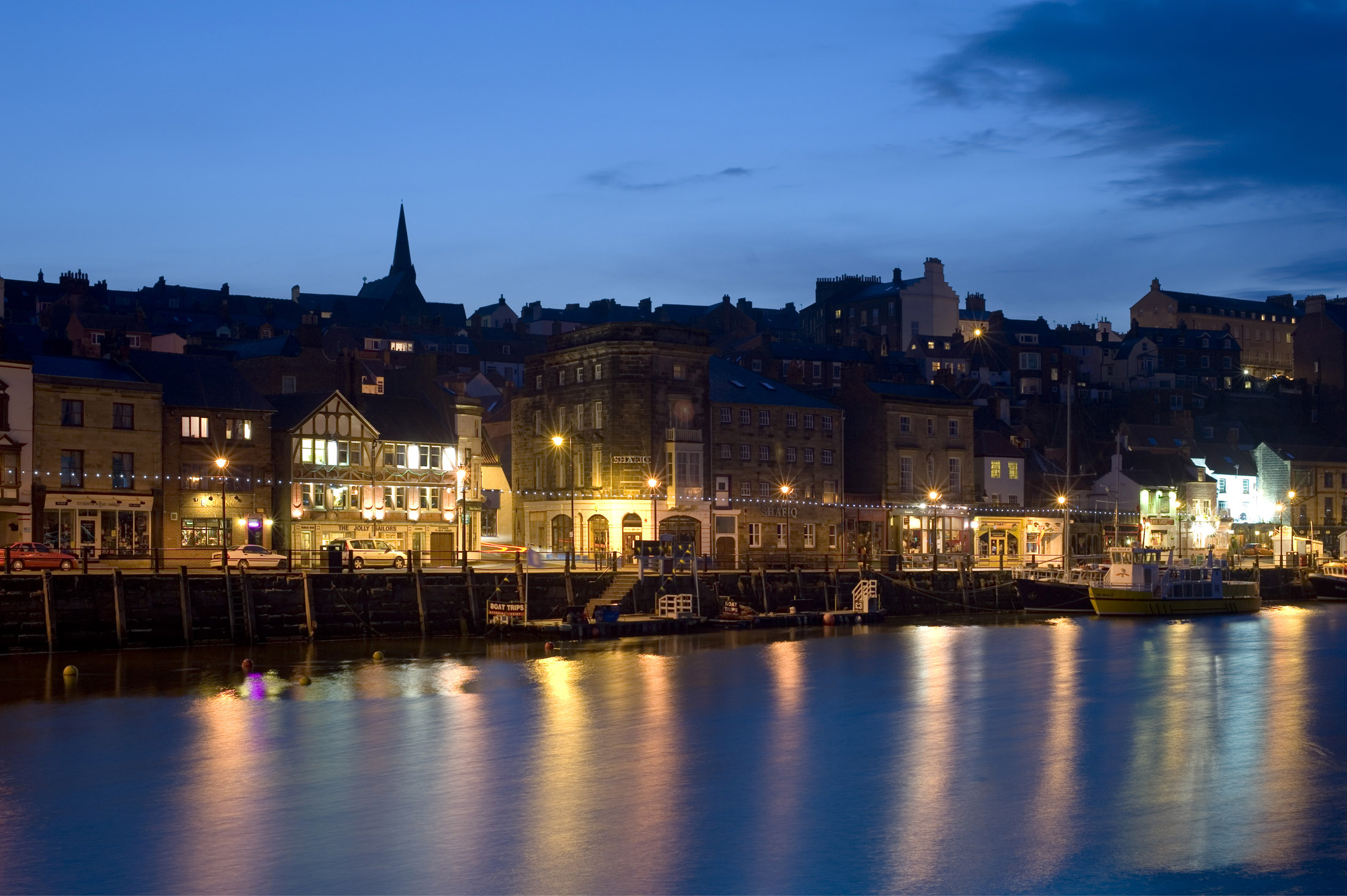 a view of st annes staith whitby, lit up at light