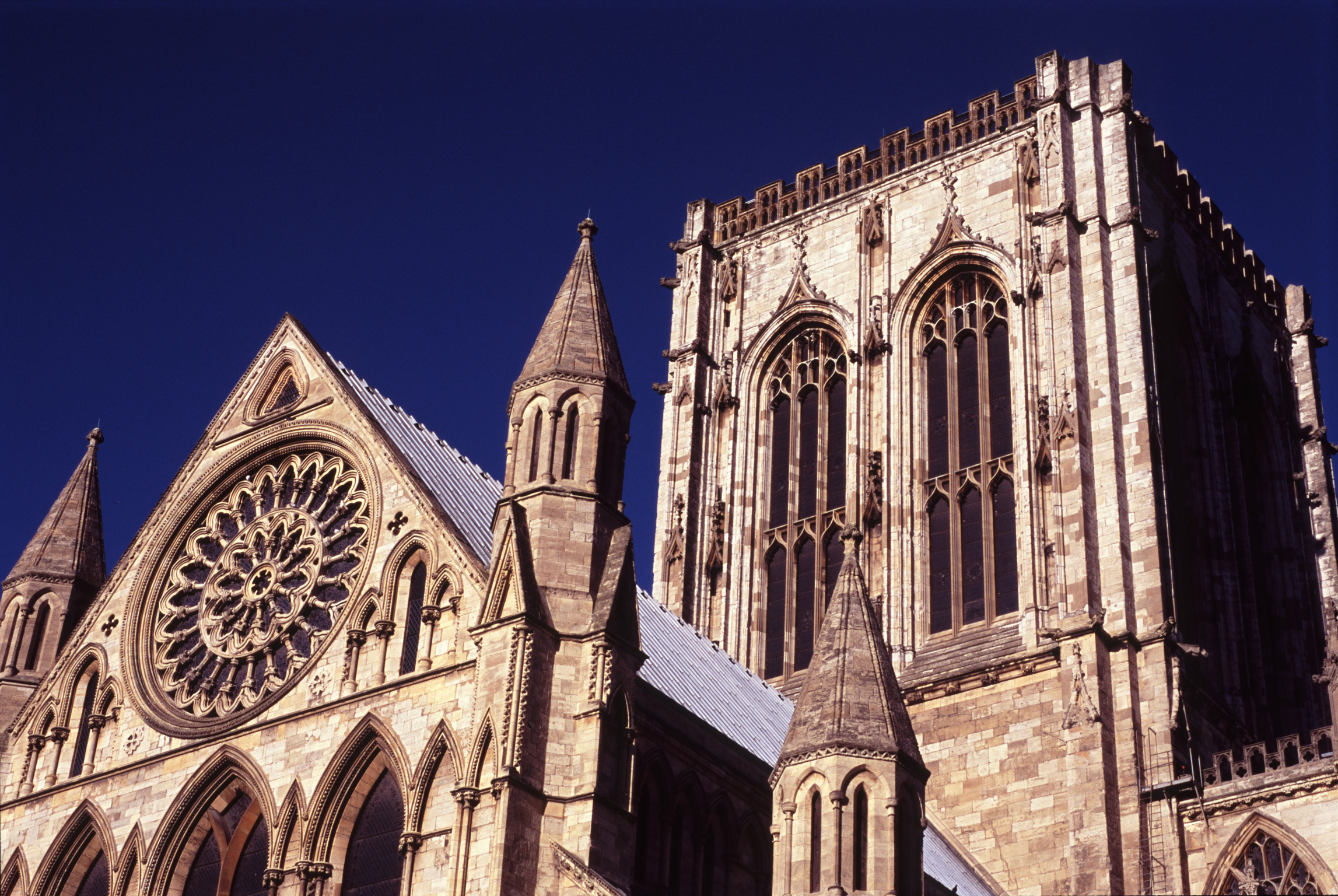 A view of York Minster against a deep blue sky