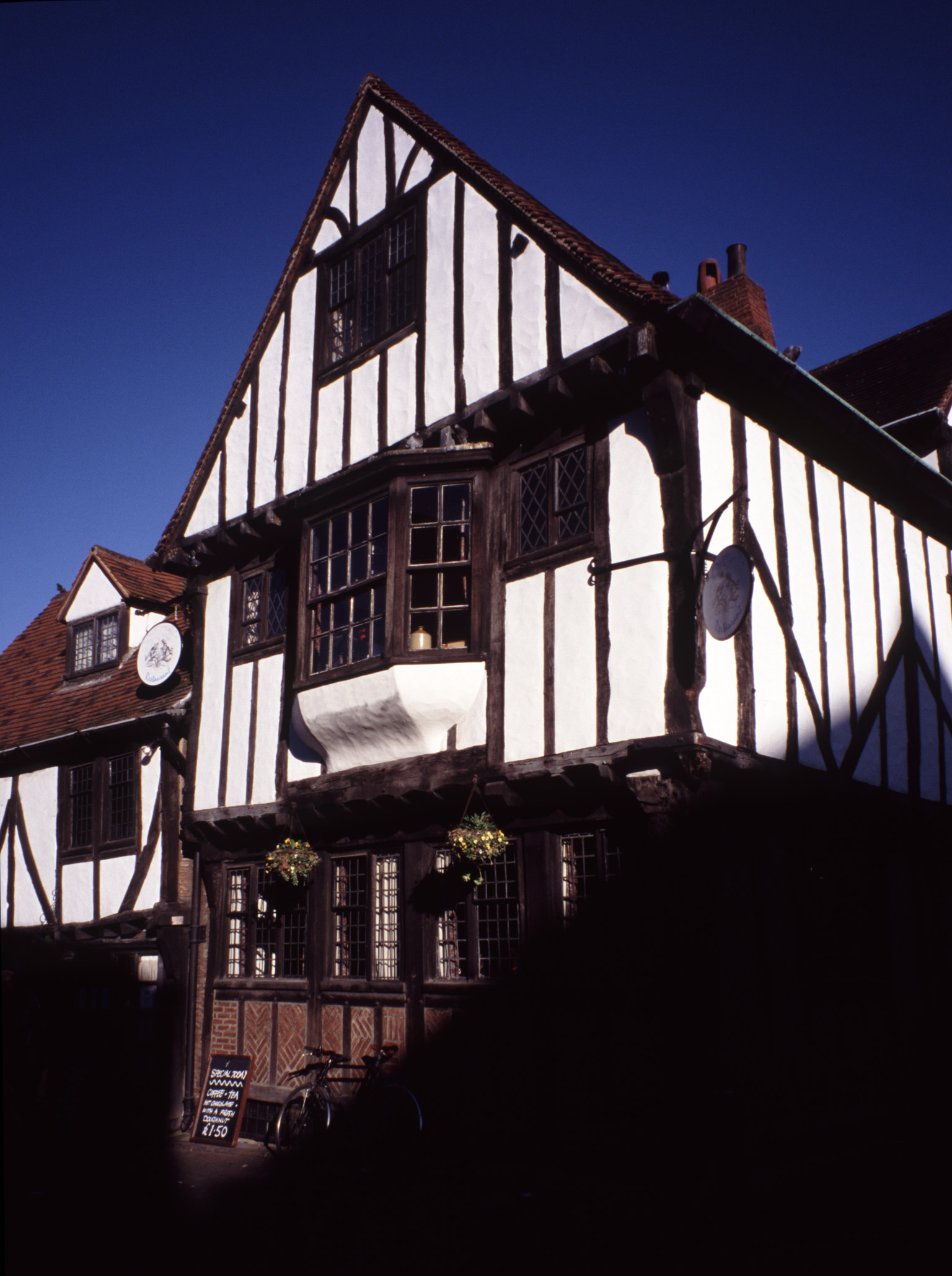 Traditional timber framed Tudor house with an overhanging bay window in York, UK