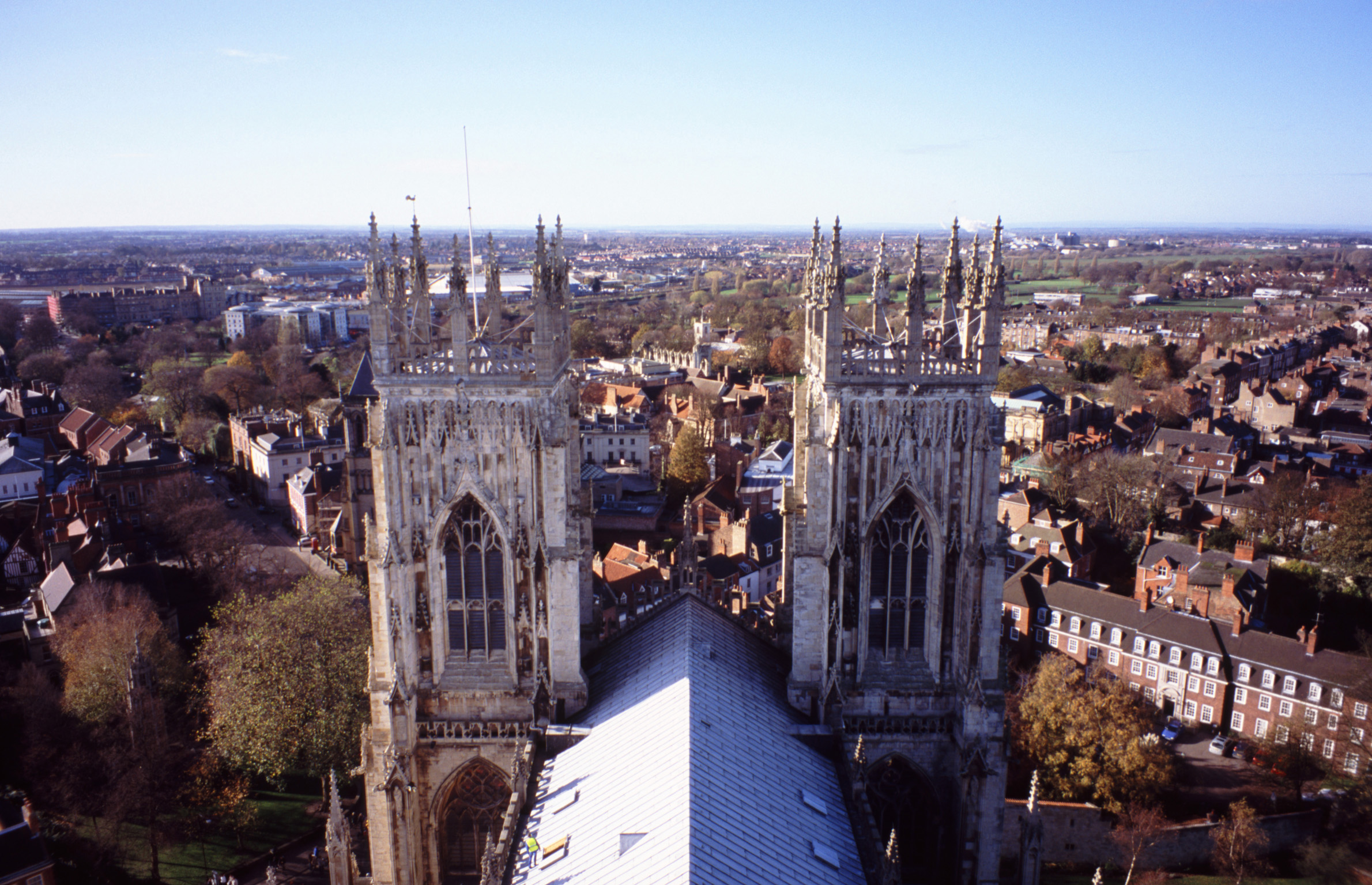 Aerial view of the twin towers on York Minster cathedral overlooking the city and skyline on a sunny blue sky day