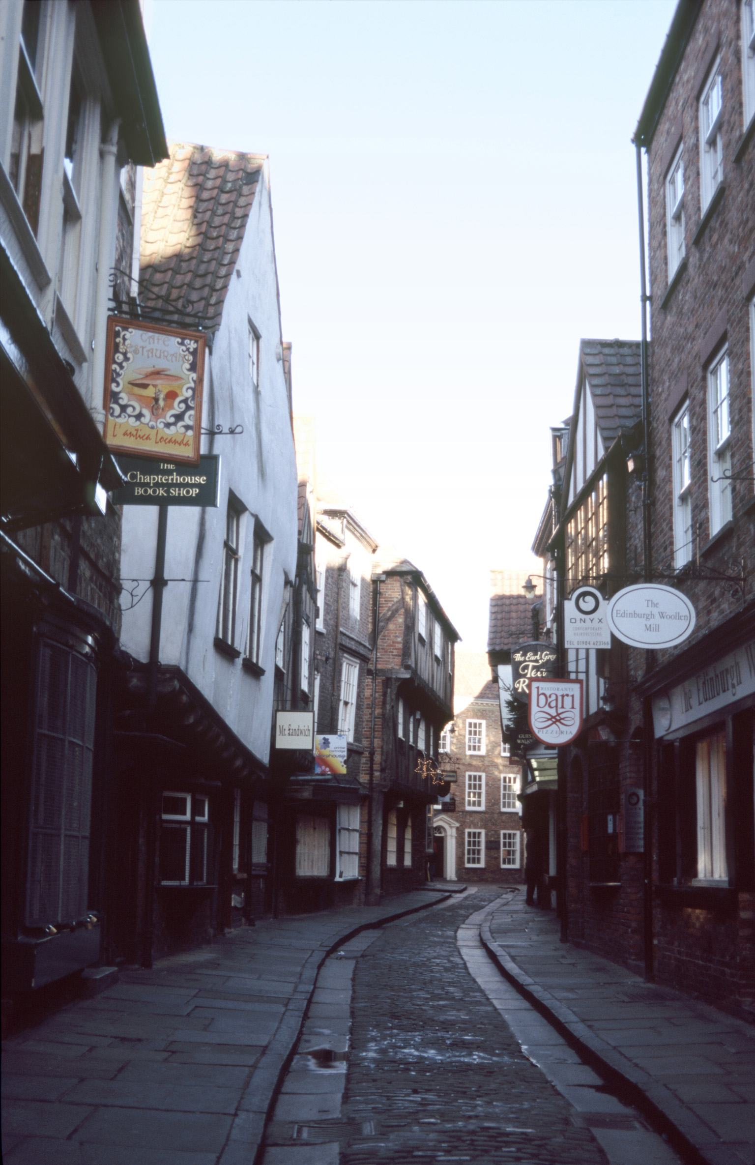 The Shambles, York, a tourist trap with quaint shops lining a narrow cobbled street in a picturesque view