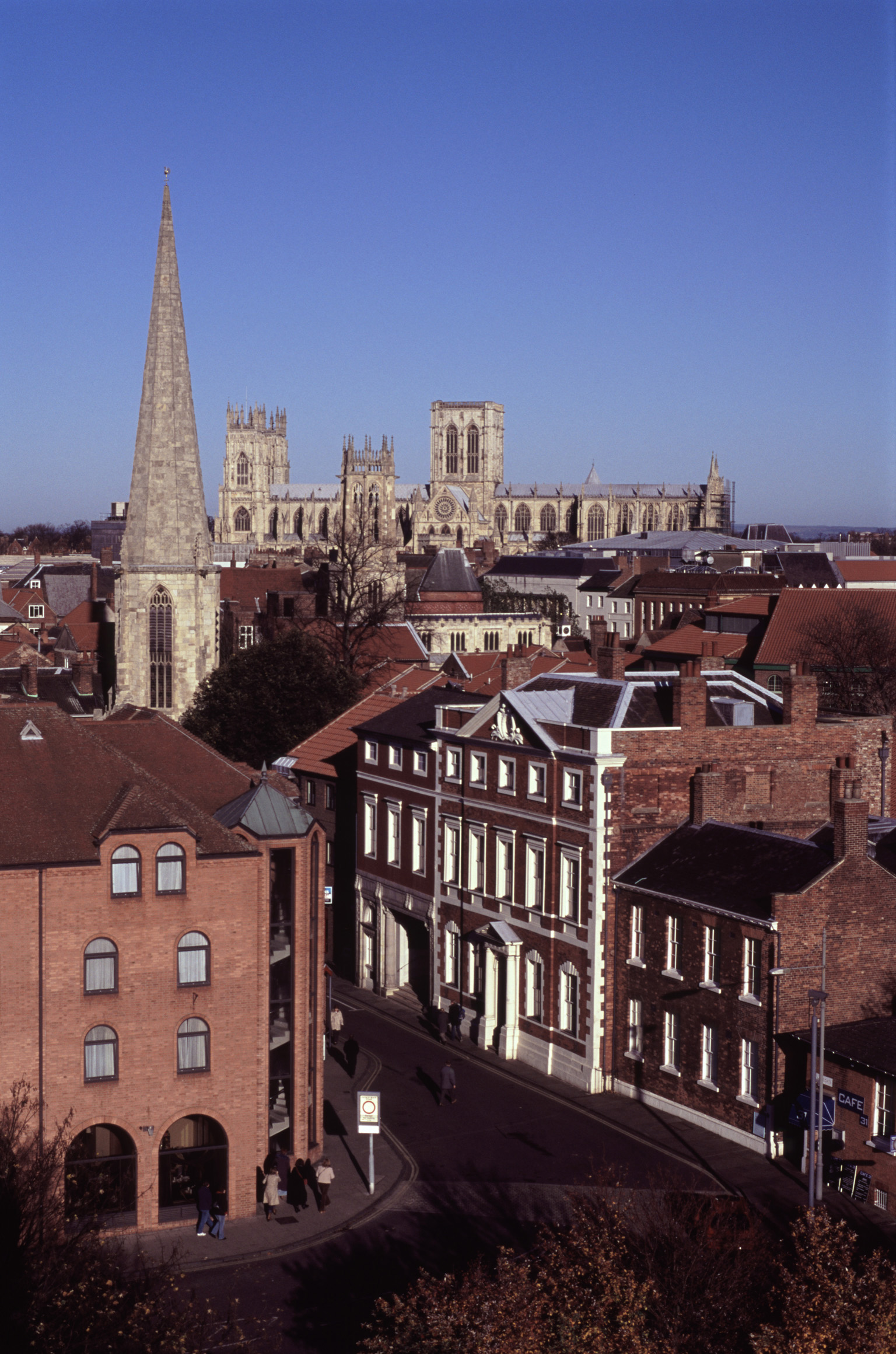 Aerial View of Historic Buildings and Streets at York, England. Captured with Light Blue Sky Background.