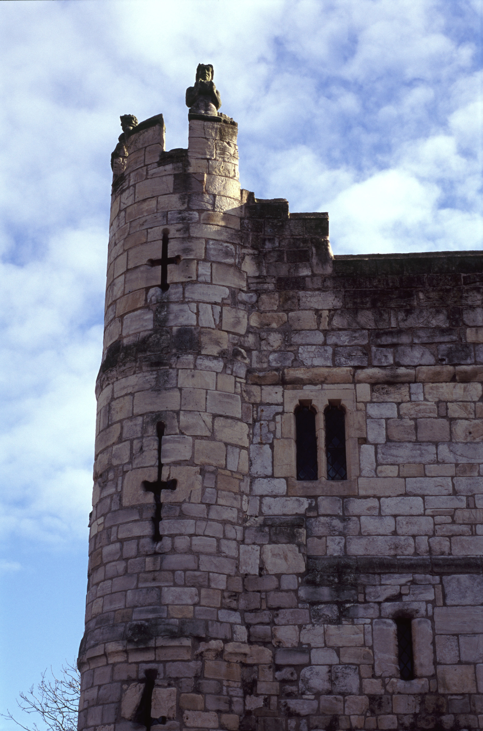 Fortified York bar with its narrow arrow holes in the circular crenellated tower of the gatehouse in York, UK