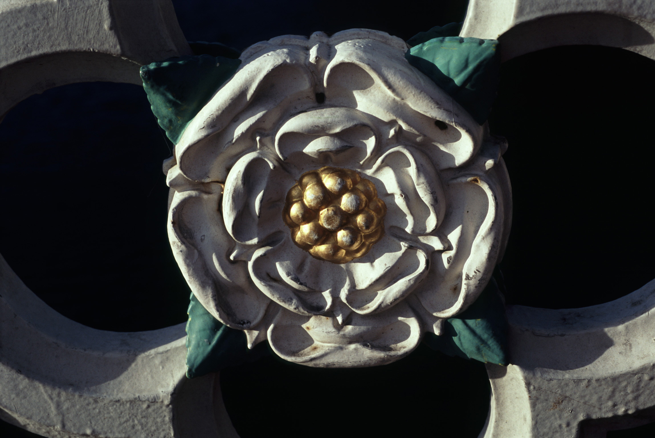 Close up Simple Vintage White Rose Sculpture at Minister Rose Window with Black Background.