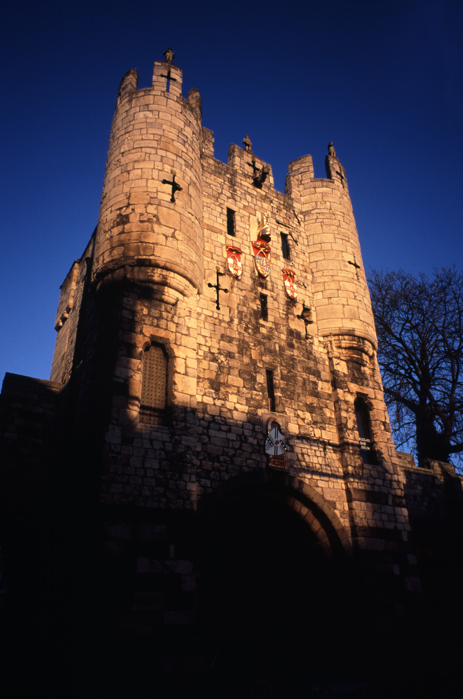 Landmark of Micklegate Bar in York, England. Captured During Sundown Time with Dark Blue Sky Above.