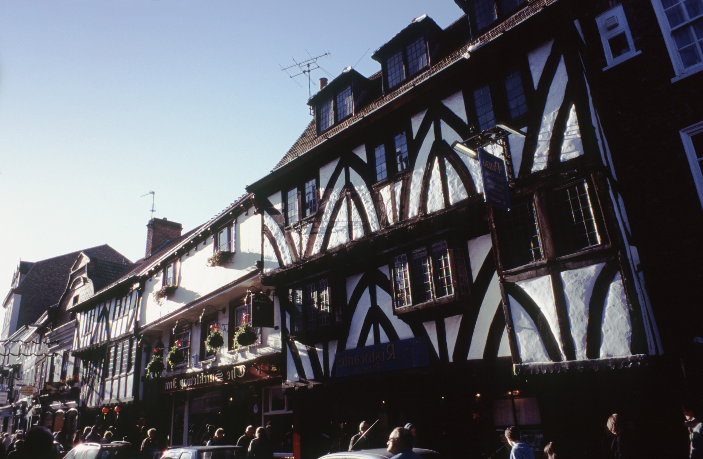 Traditional historical Tudor timber framed houses in York with overhanging bay windows in an architectural and travel background