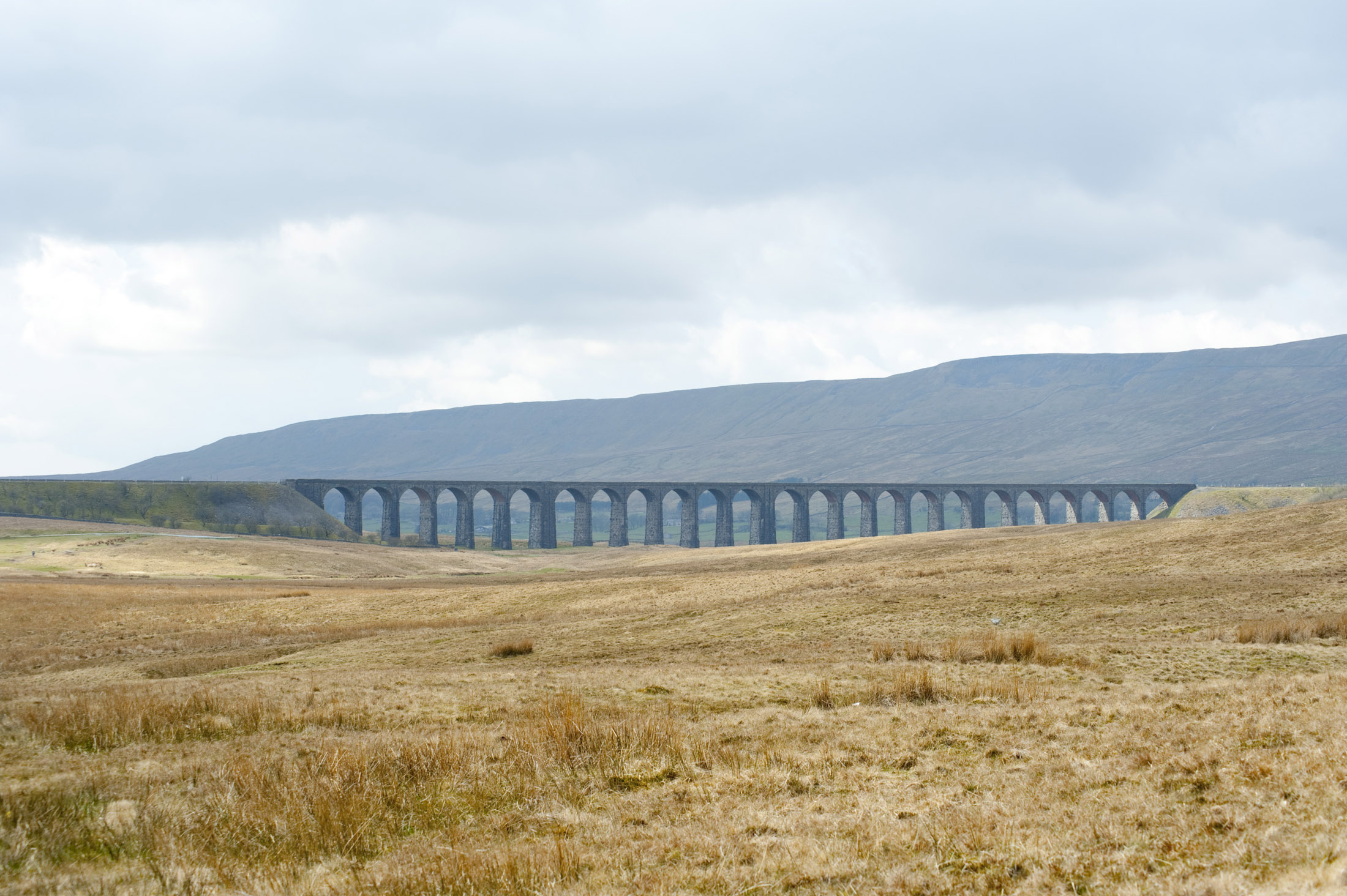 a distant view of the ribble head viaduct, yorkshire, england