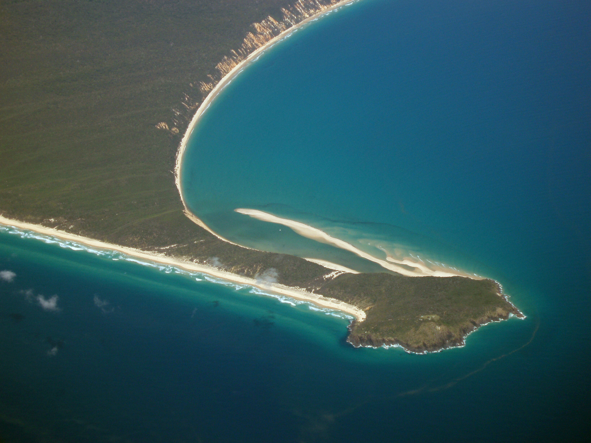 Beautiful Double Island Point at Queensland Surrounded by Blue Water Ocean. Captured in Aerial View