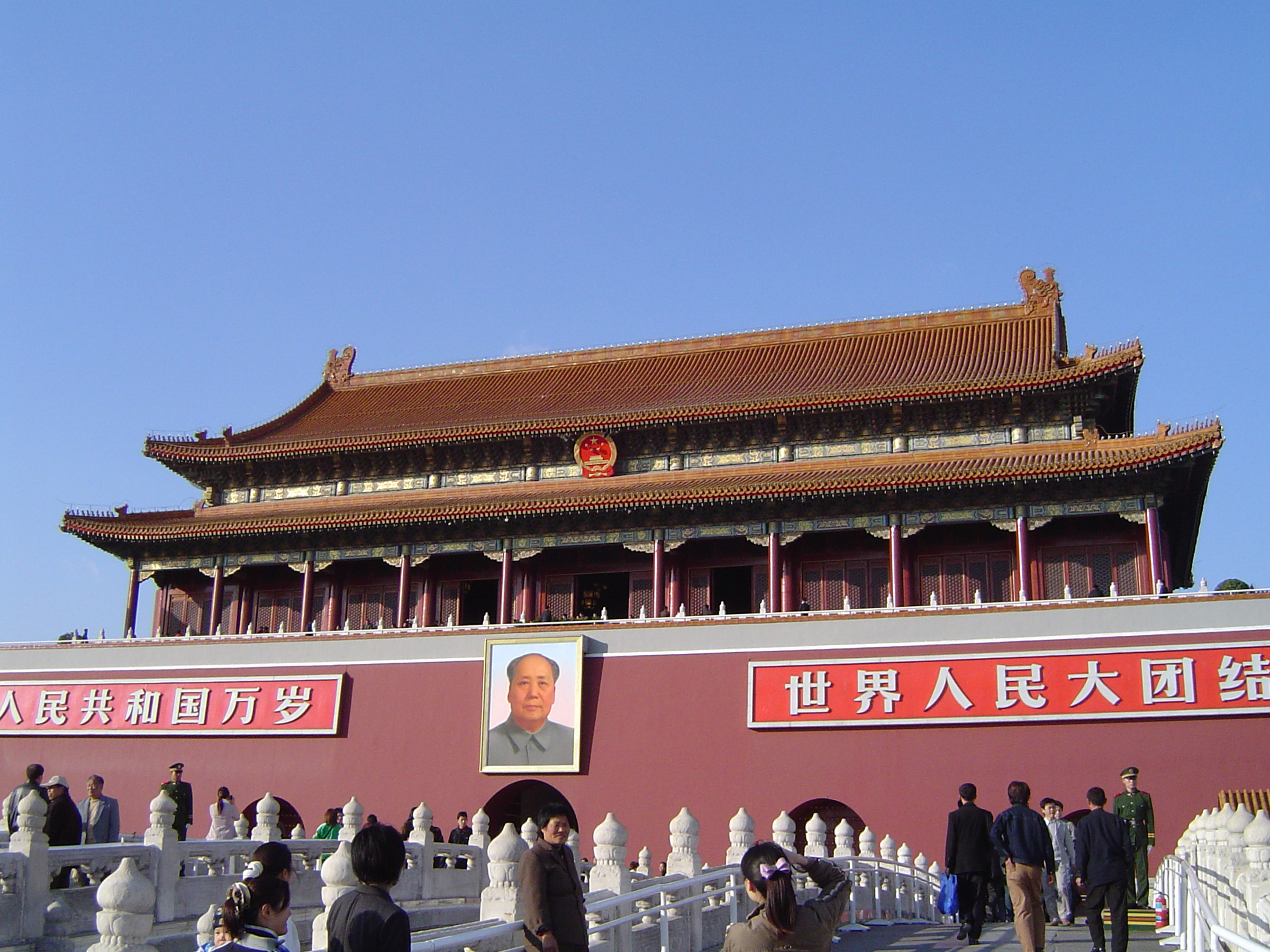 Famous Forbidden City Building with Random Visitors in China. Captured on Morning Time with Light Blue Sky Background.