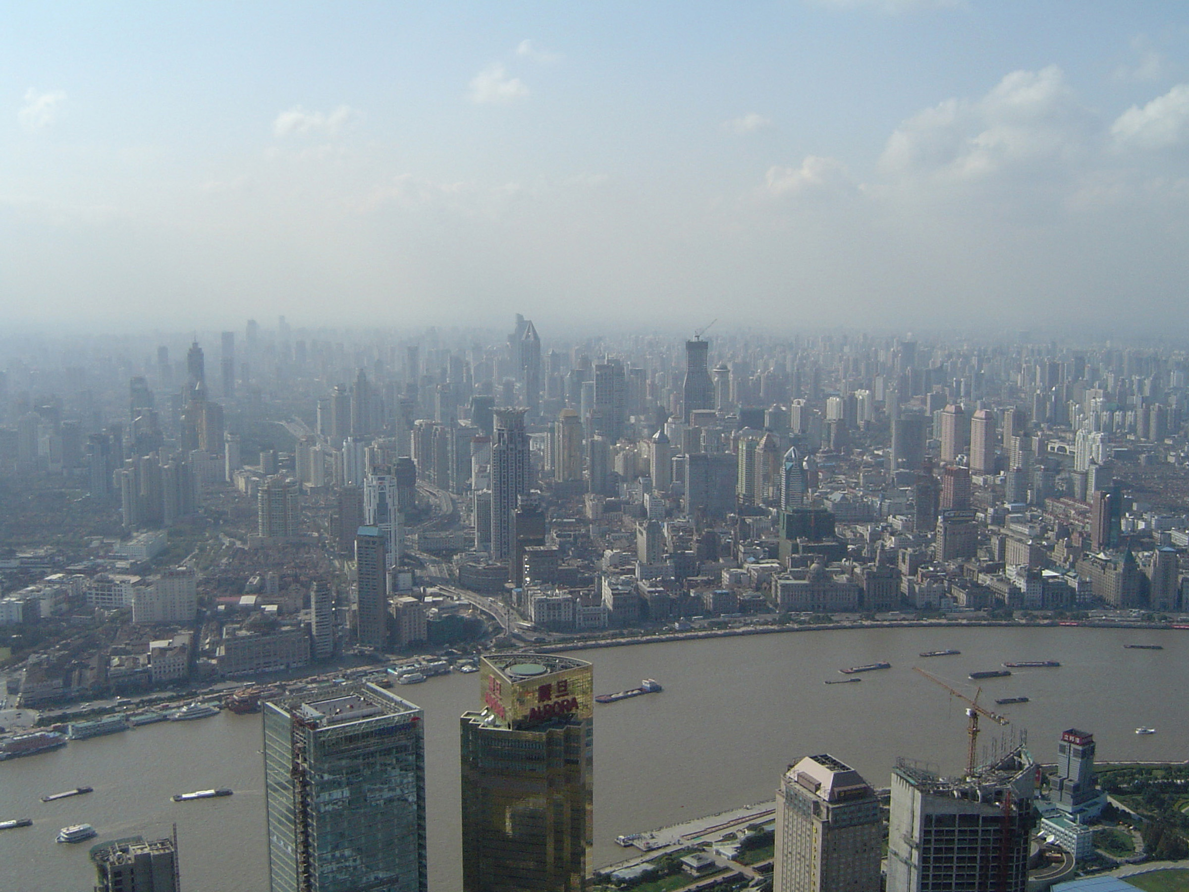 Aerial City View of China with Huge River and Assorted Buildings View. Emphasizing Obvious Air Pollution.