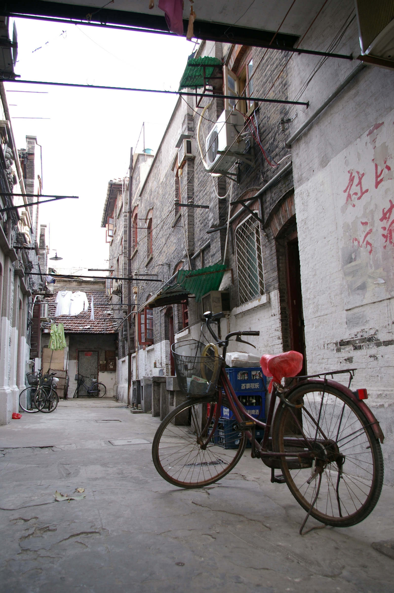 Old Bicycle at Vintage Compound Pathway with Ordinary Houses on Sides in China