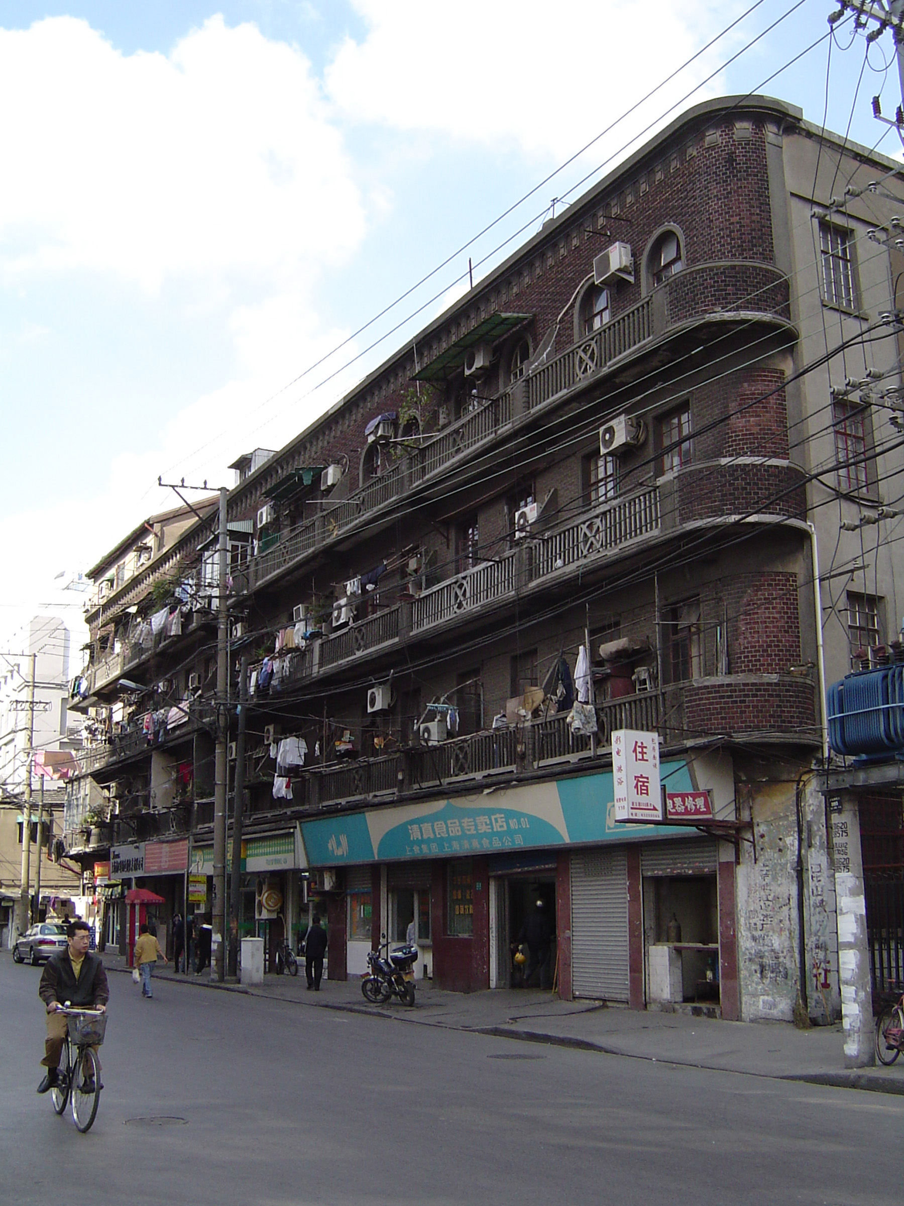 Huge Vintage Building on Chinese Street Side, Captured with Bicycle Passing by