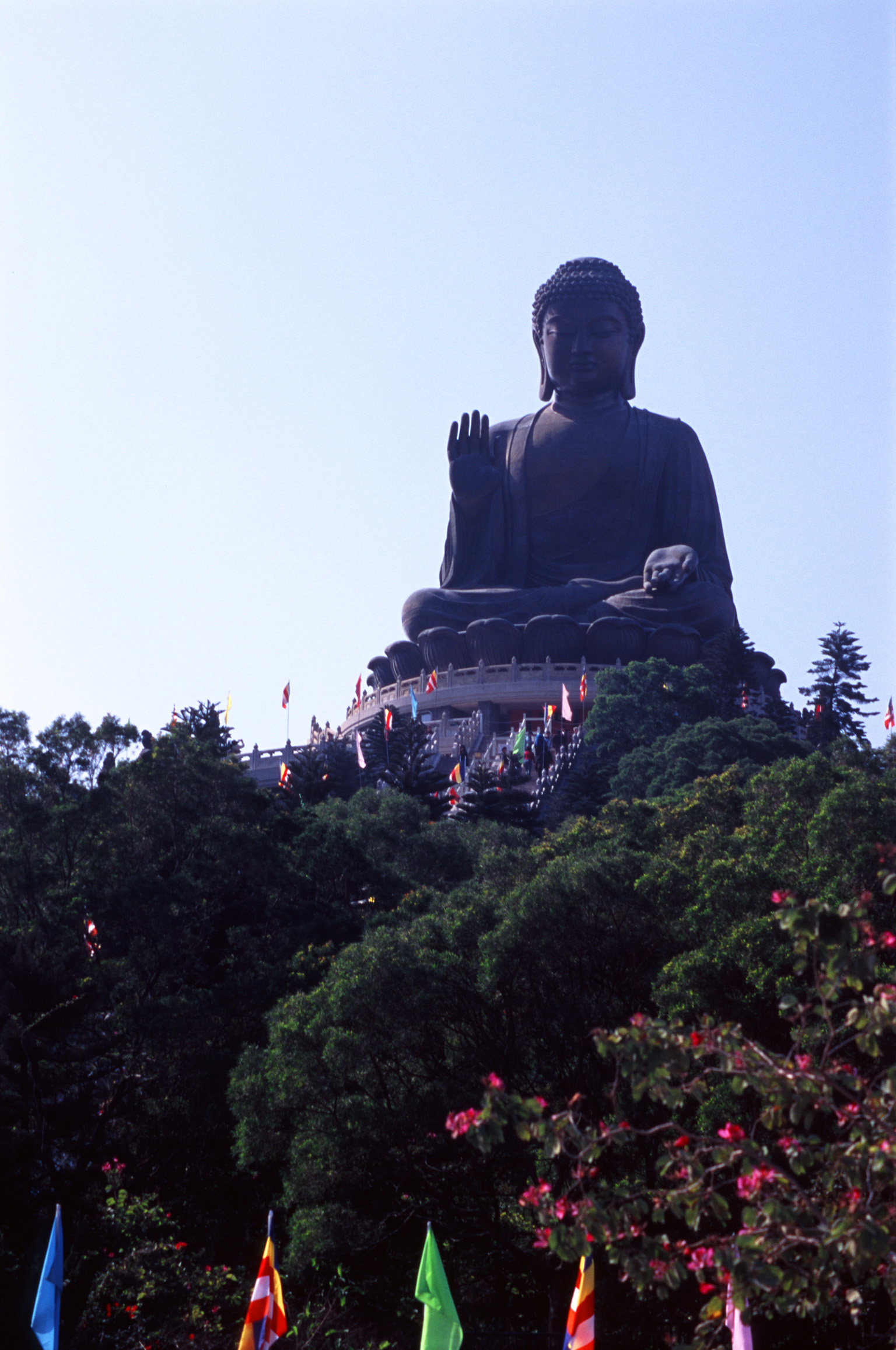 Famous Vintage Big Tian Tan Buddha Structure in Lantau Island, Hong Kong. Surrounded by Tall Green Trees.