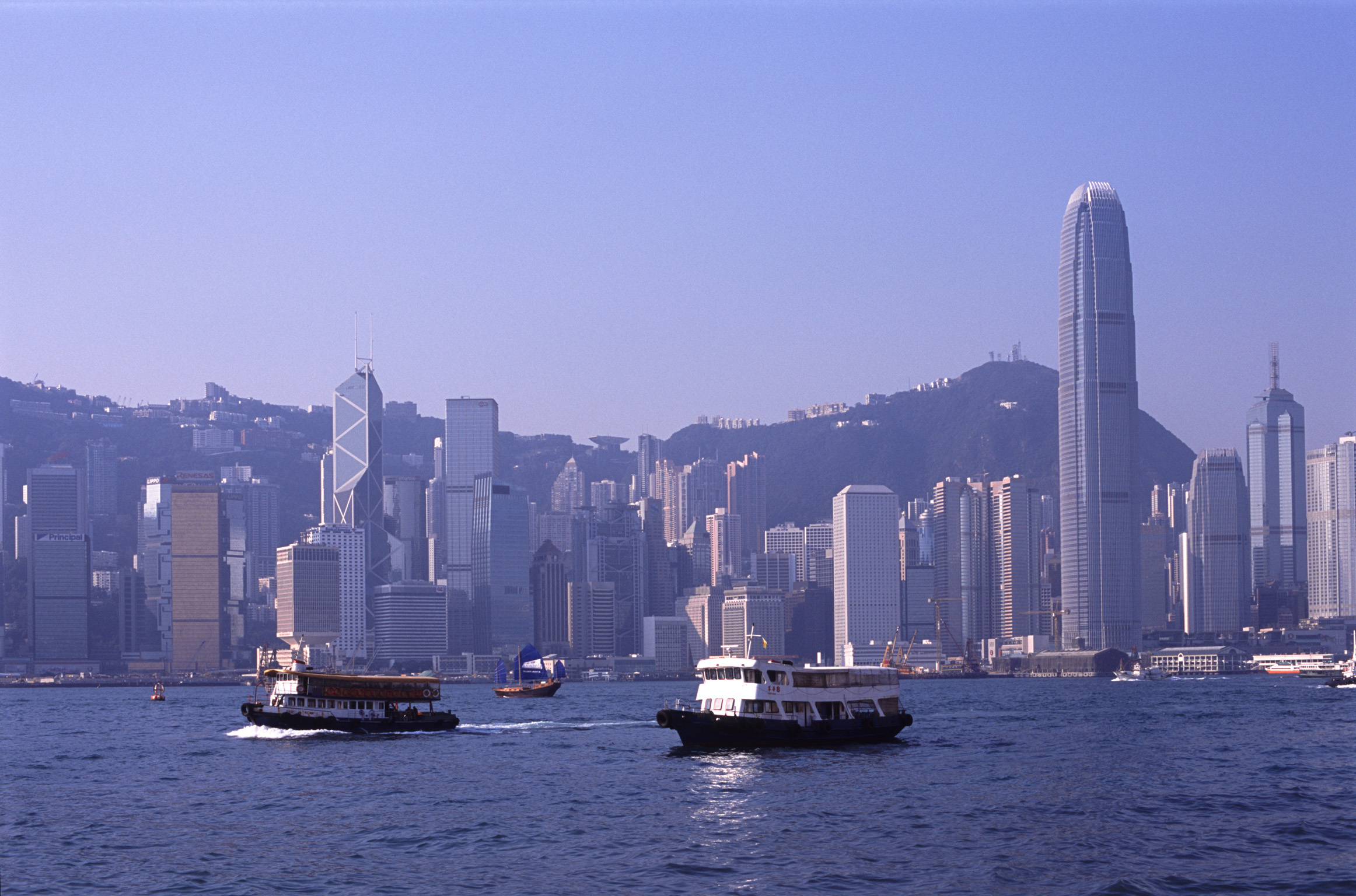 Star Ferry in Victoria Harbor with Hong Kong Skyline, China