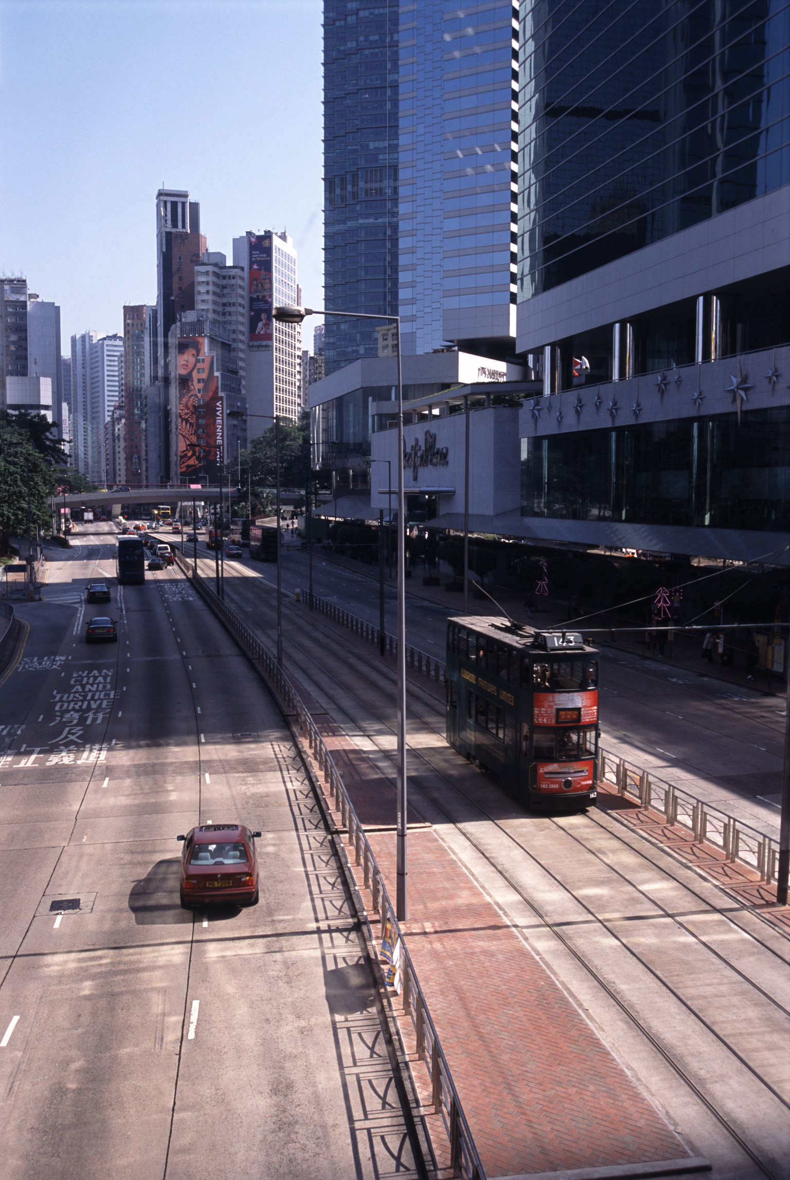 No Traffic City Streets For Cars and Trams in Hong Kong China with High Rise Architectural Buildings on the Sides.