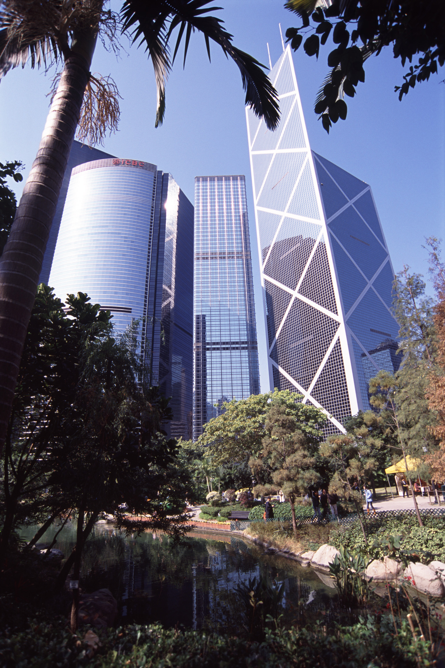 downtown hongkong, modern skyscrapers seen from the contrasting tranquility of an urban park