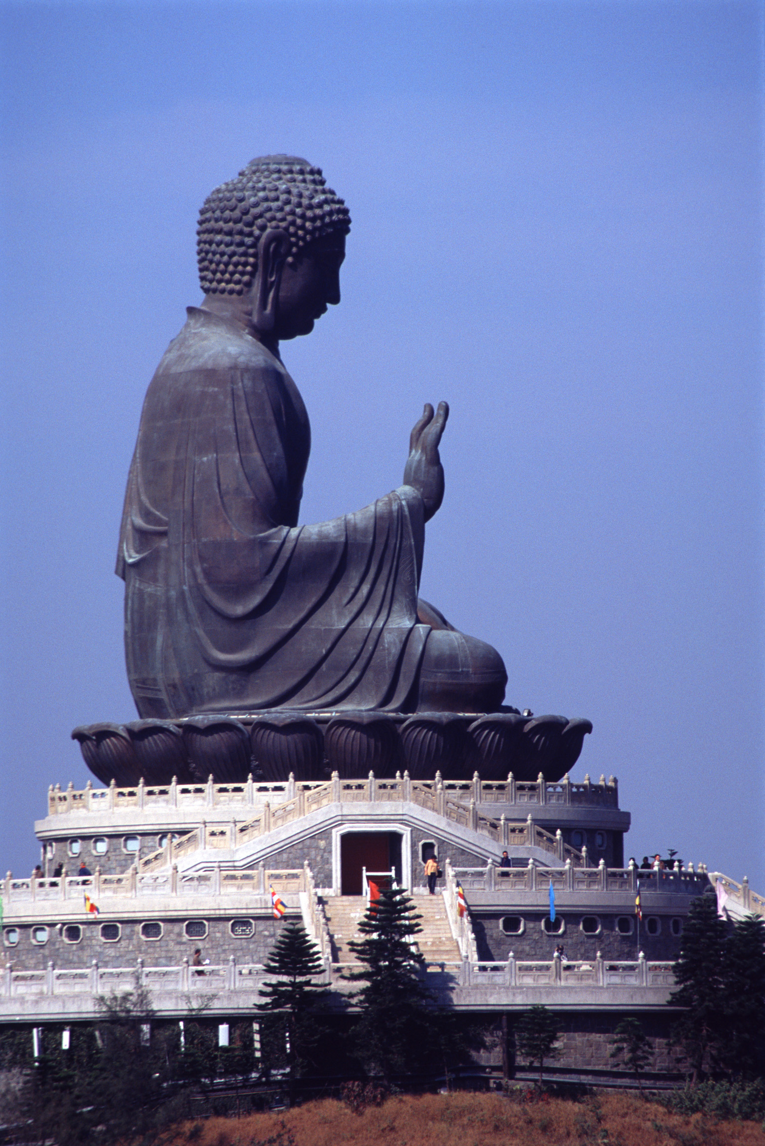 Big Buddha statue, Hong Kong, Tian Tan Buddha, also known as the Big Buddha, is a large bronze statue of a Buddha Amoghasiddhi situated on a moutain peak above the monastery on Lantau Island