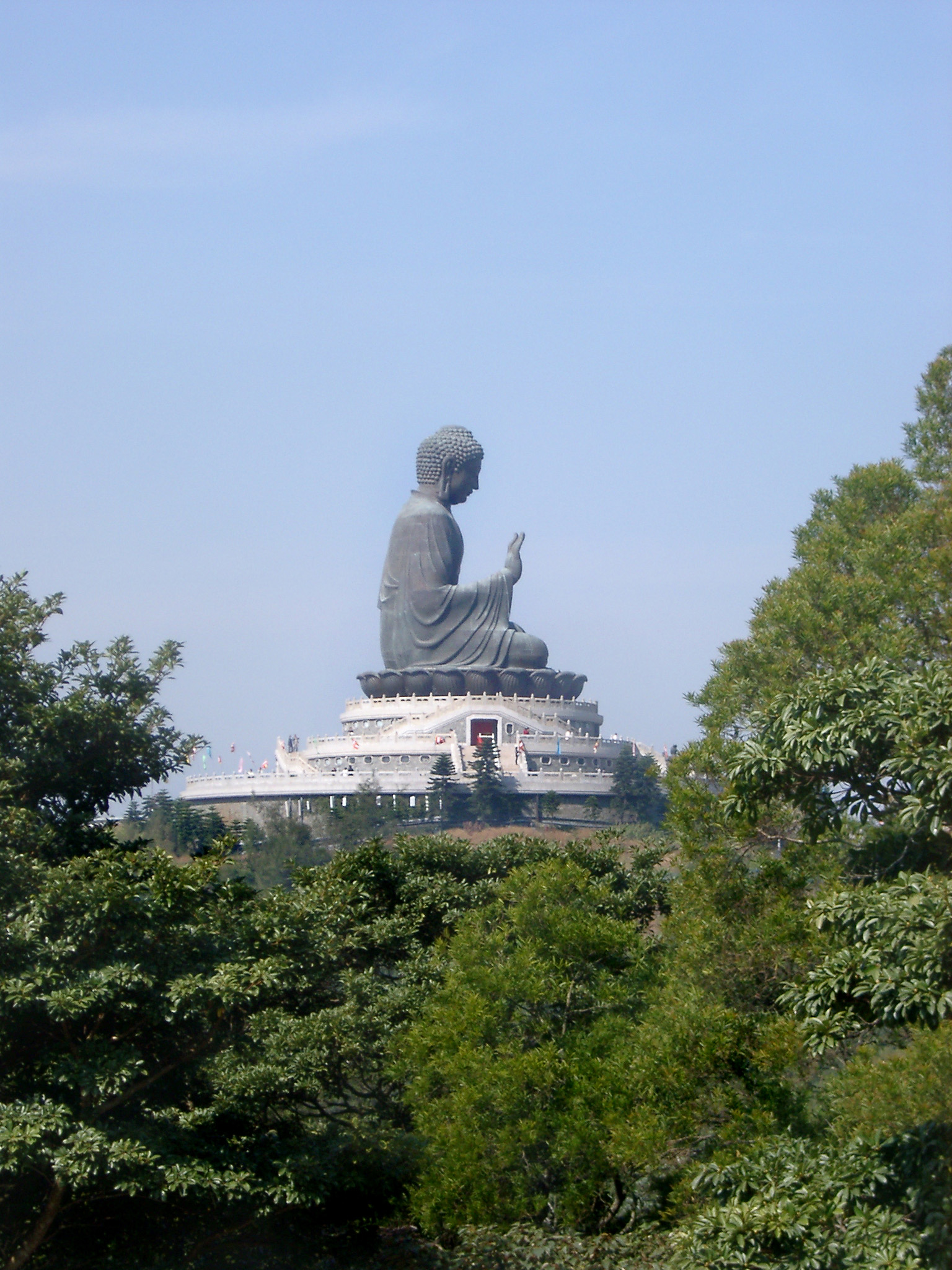 Famous Historic Tian Tan Buddha Sculpture on Blue Sky Background. Captured in Side View.