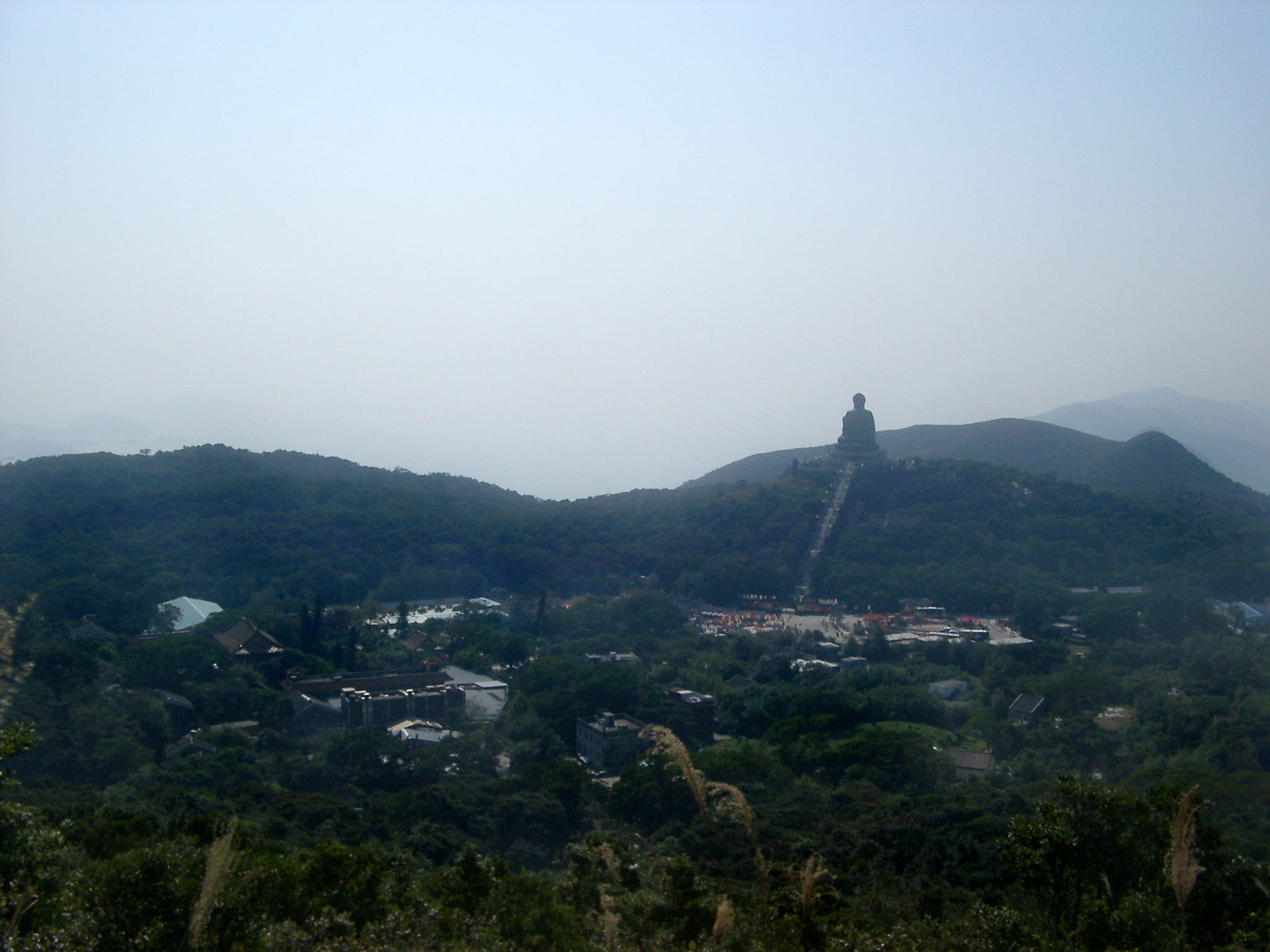 Panorama Natural View in Hong Kong with Famous Vintage Big Buddha Structure on Hill Top.