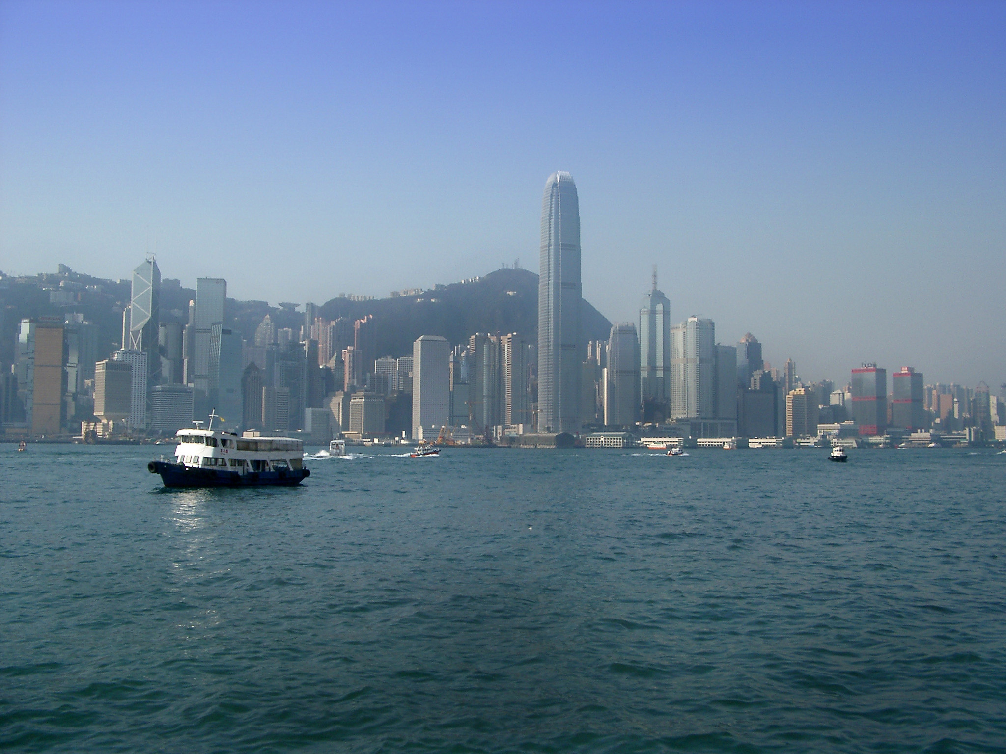 Star Ferry in Victoria Harbor with Hong Kong City Skyline, China