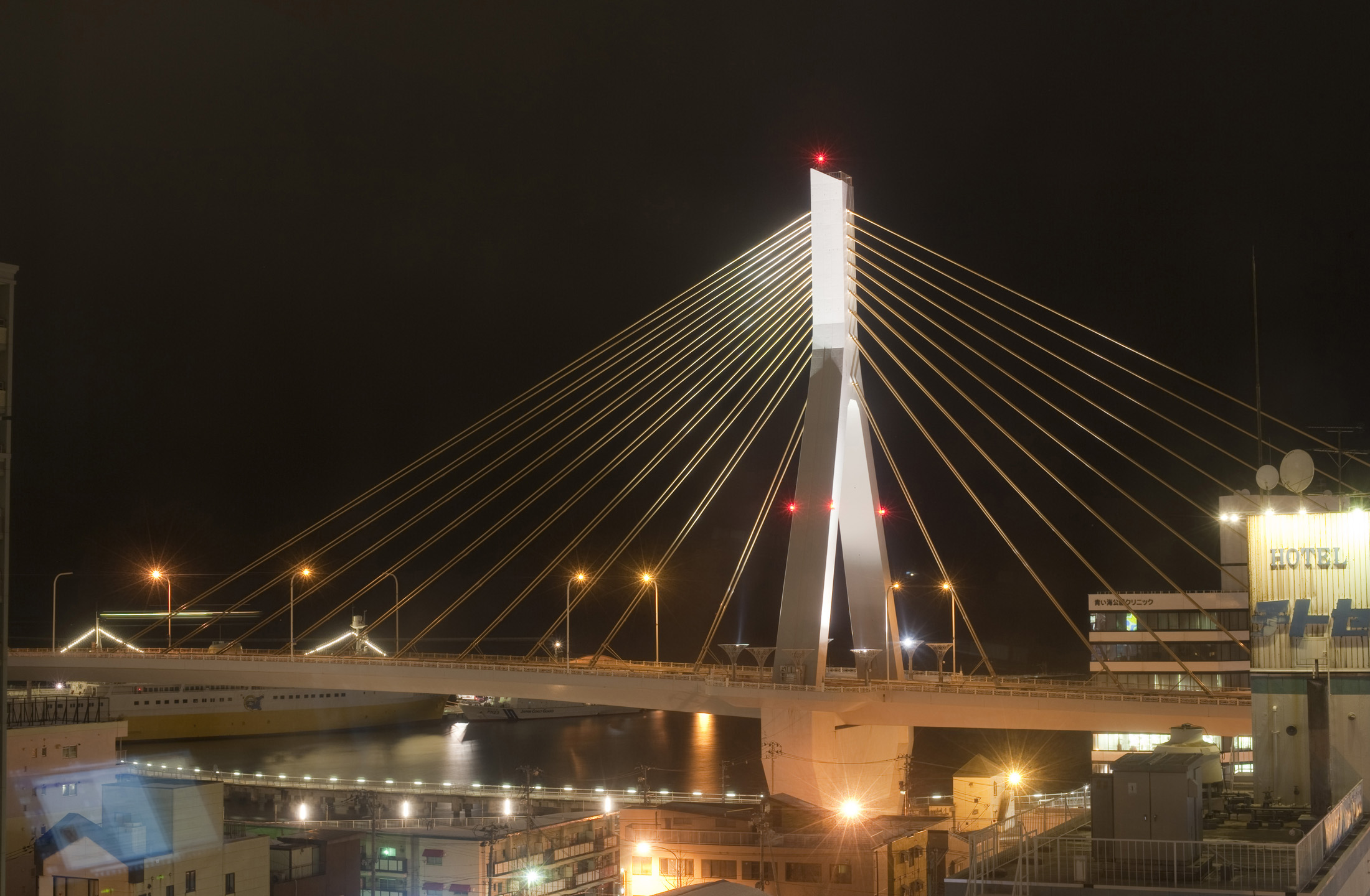 a view of the Aomori Bay Bridge at night, Aomori-shi, Japan