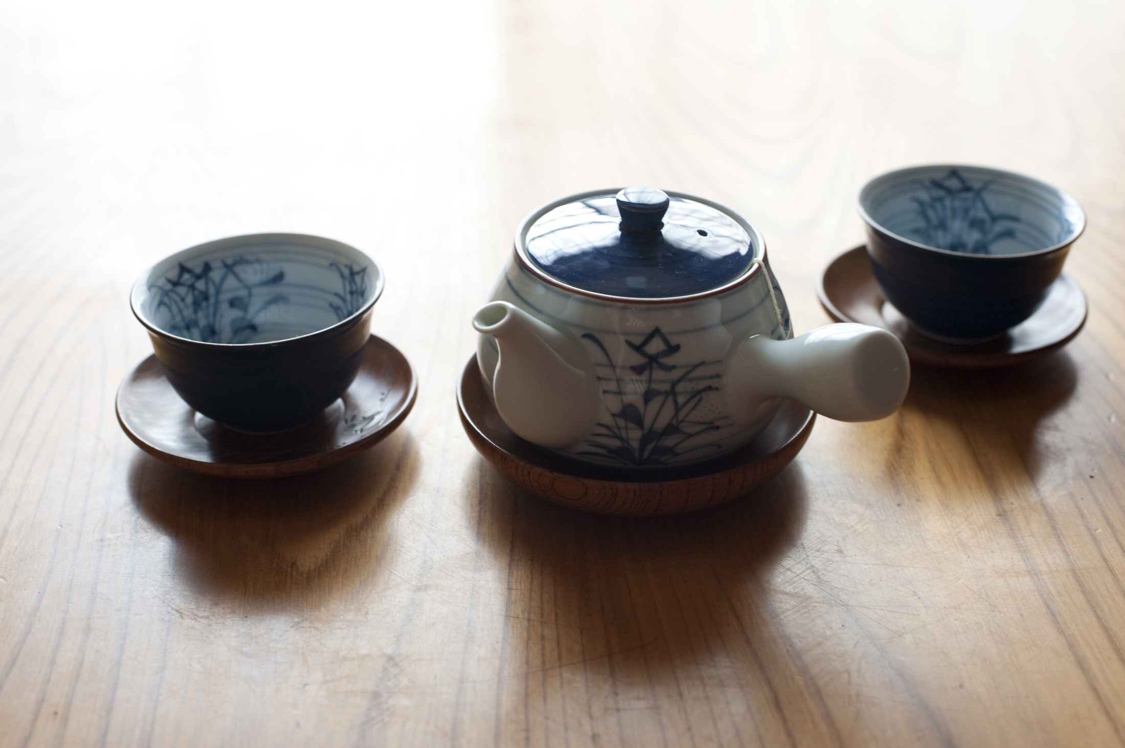 A Japanese teapot and two cups ready for a cup of green tea