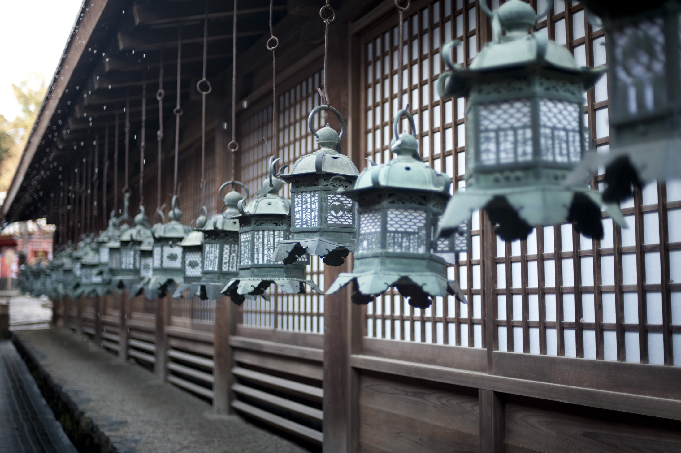 Kasuga Grand Shrine (Kasuga-taisha) a Shinto shrine in Nara, Japan, lines of brass lanterns or kondo-doro