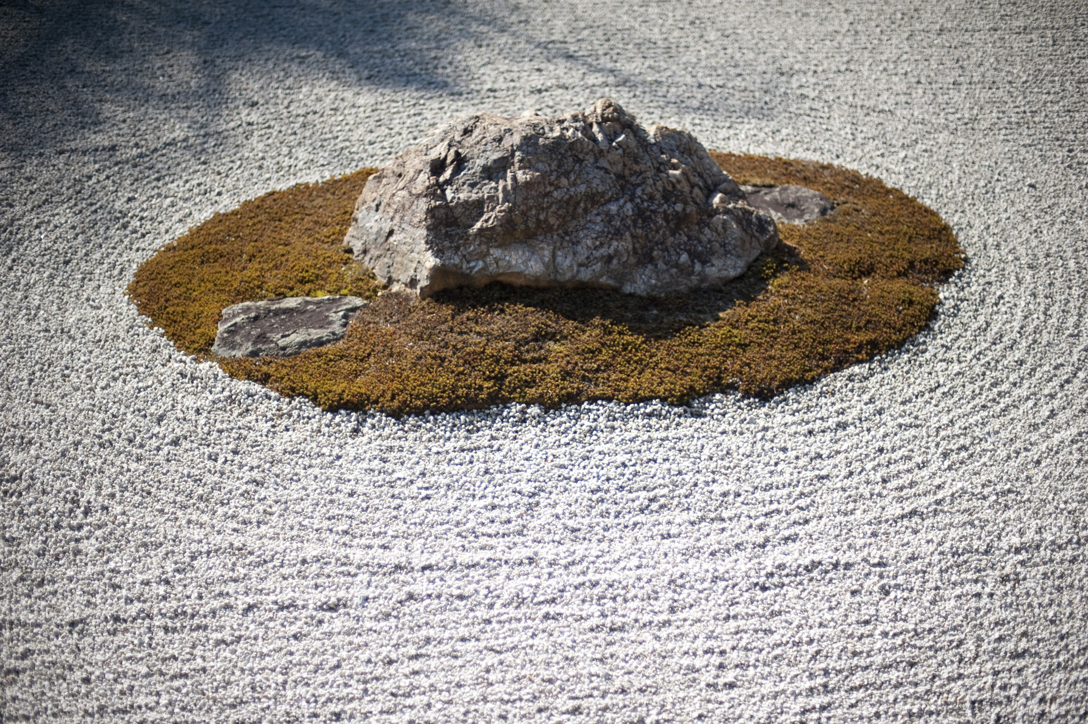 carefuly maintained, the karesansui (dry landscape) rock garden at Ryoan-ji, Kyoto, japan