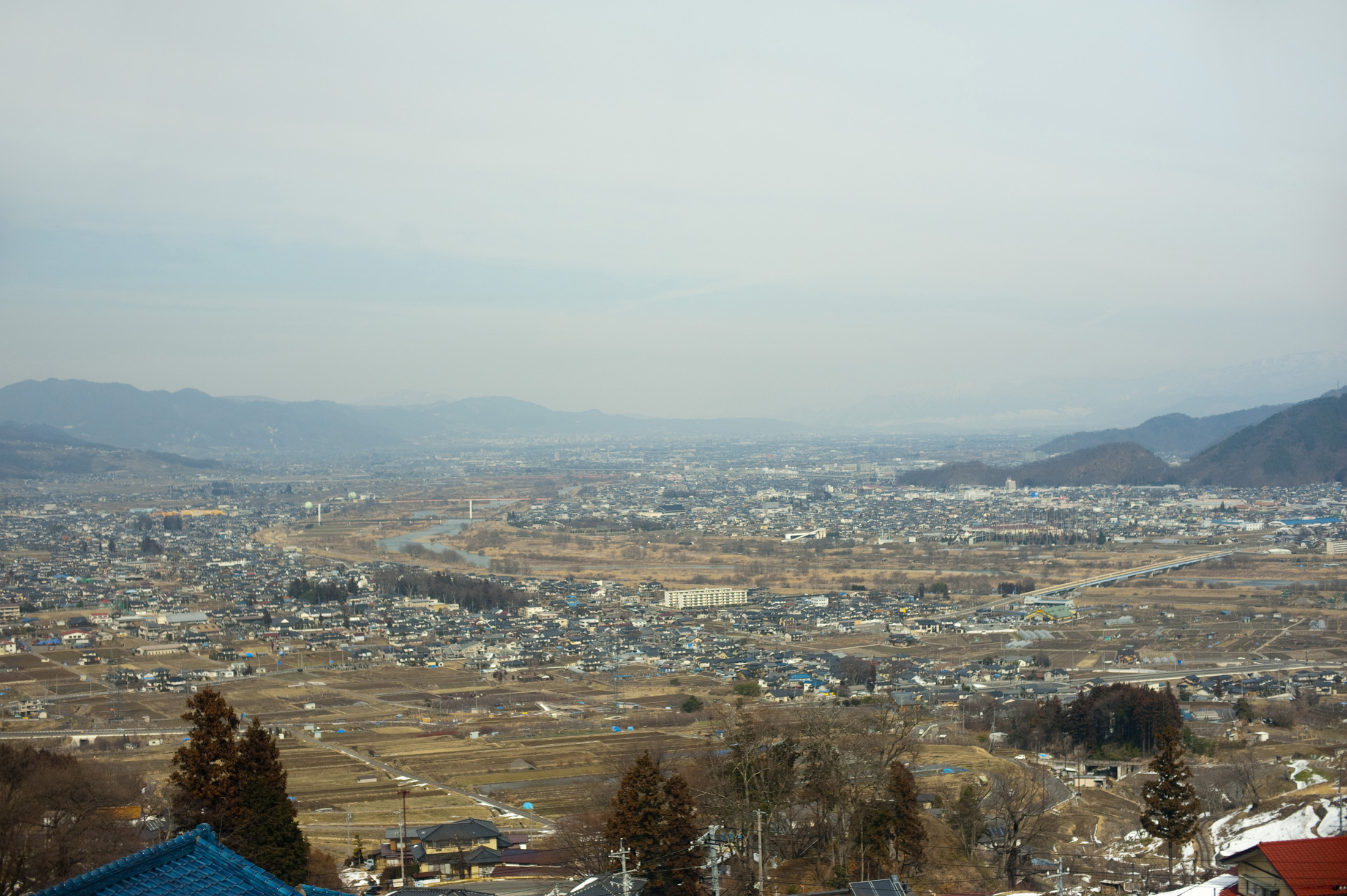 A view of the city of nagano and surrounding mountains, Japan