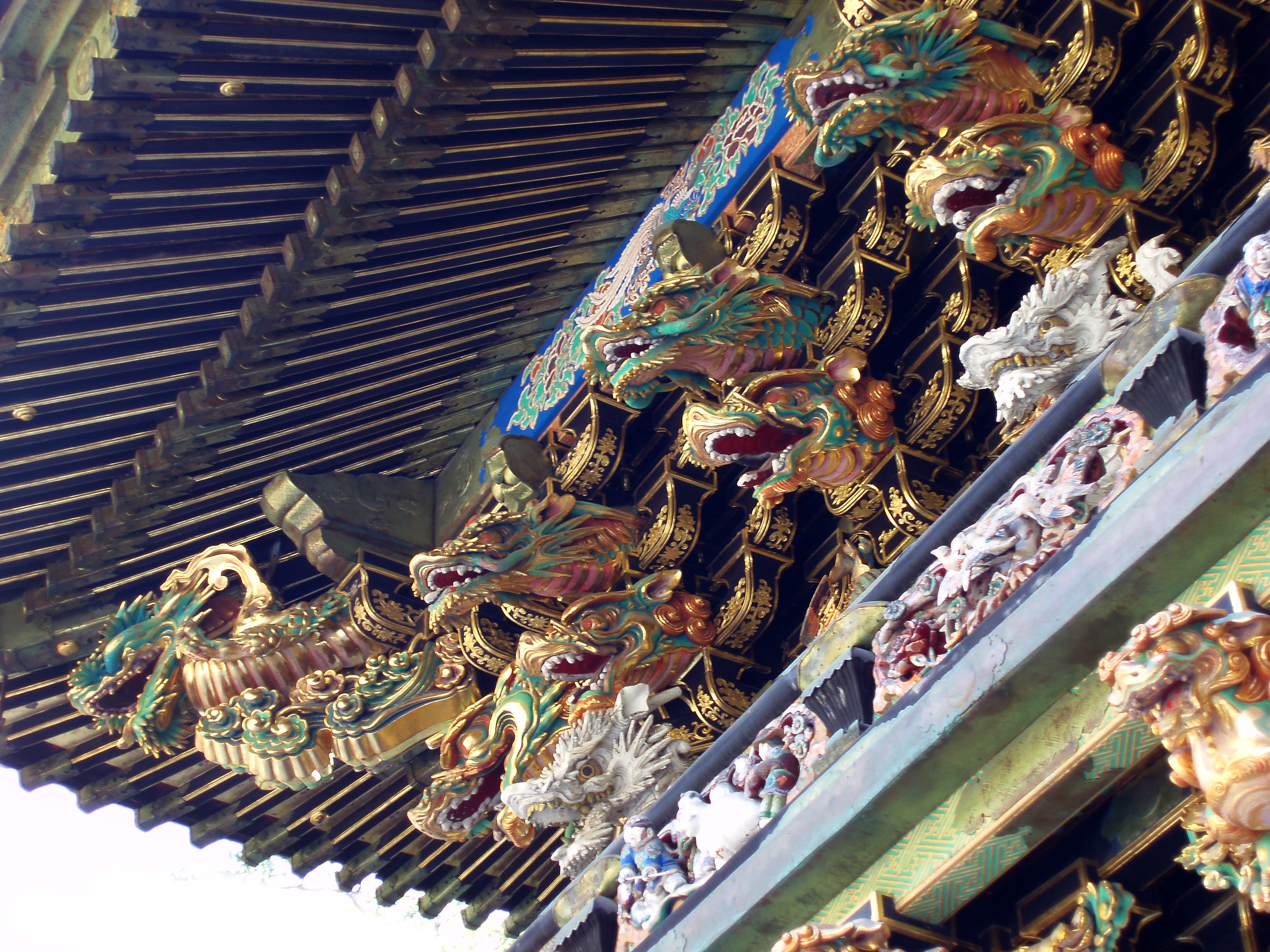 beautiful ornate gold painted carvings high on the wall of a temple, nikko japan
