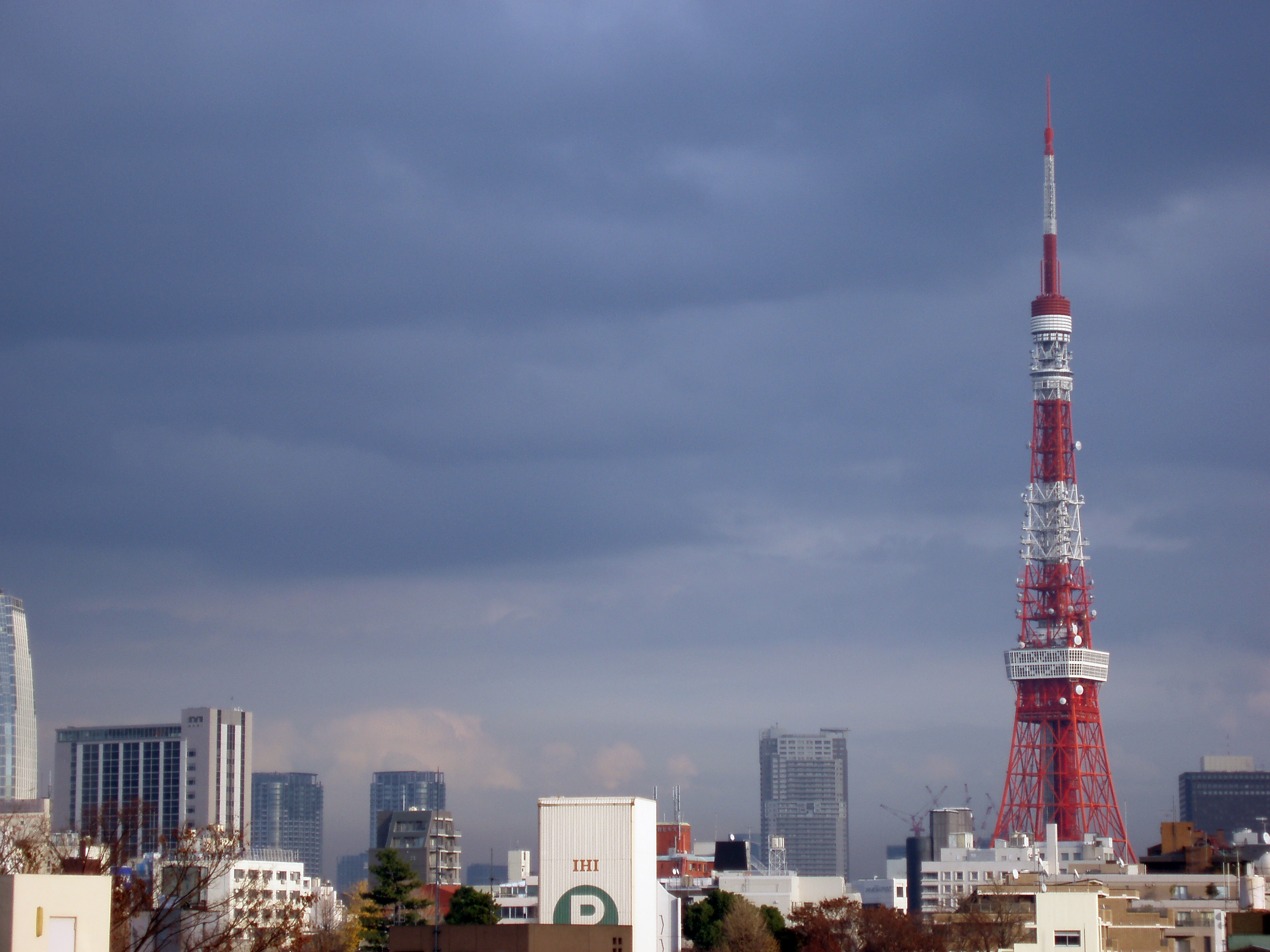 stormy sky with the tokyo tv tower at other buildings, tokyo, japan