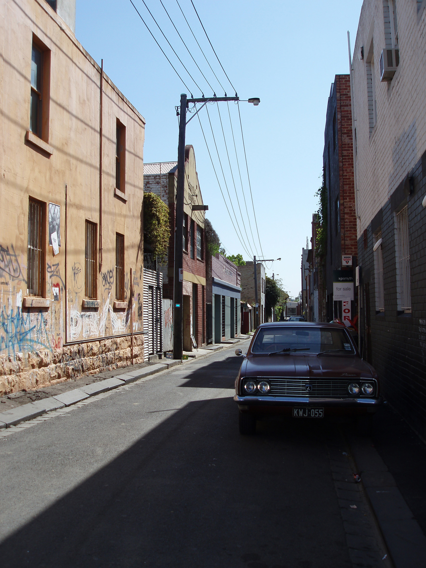 Car Parking at Fitzroy Street Between Vintage Tall Buildings at Melbourne. Captured at Morning Time.
